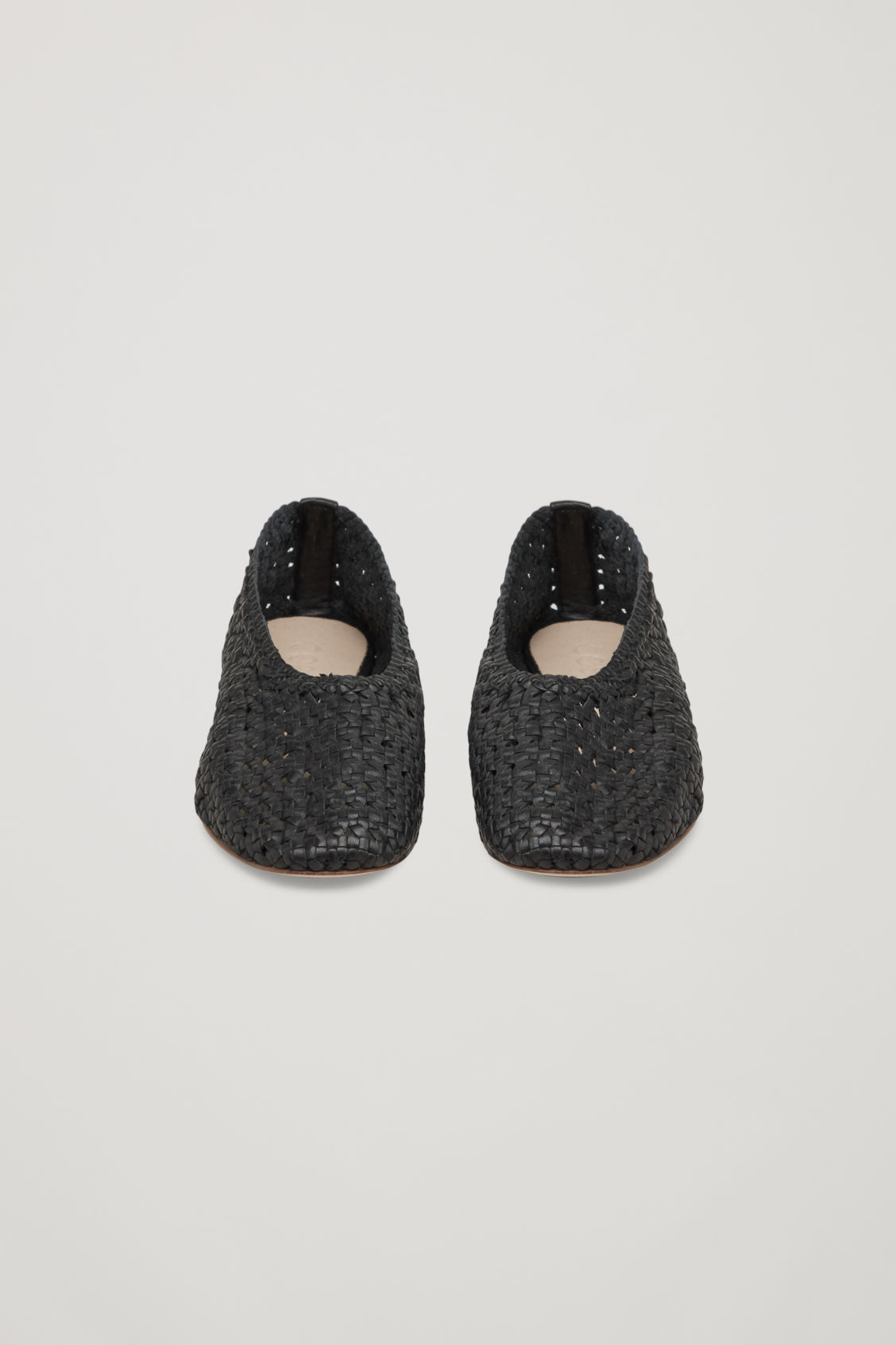 Side image of Cos braided slip-on shoes in black