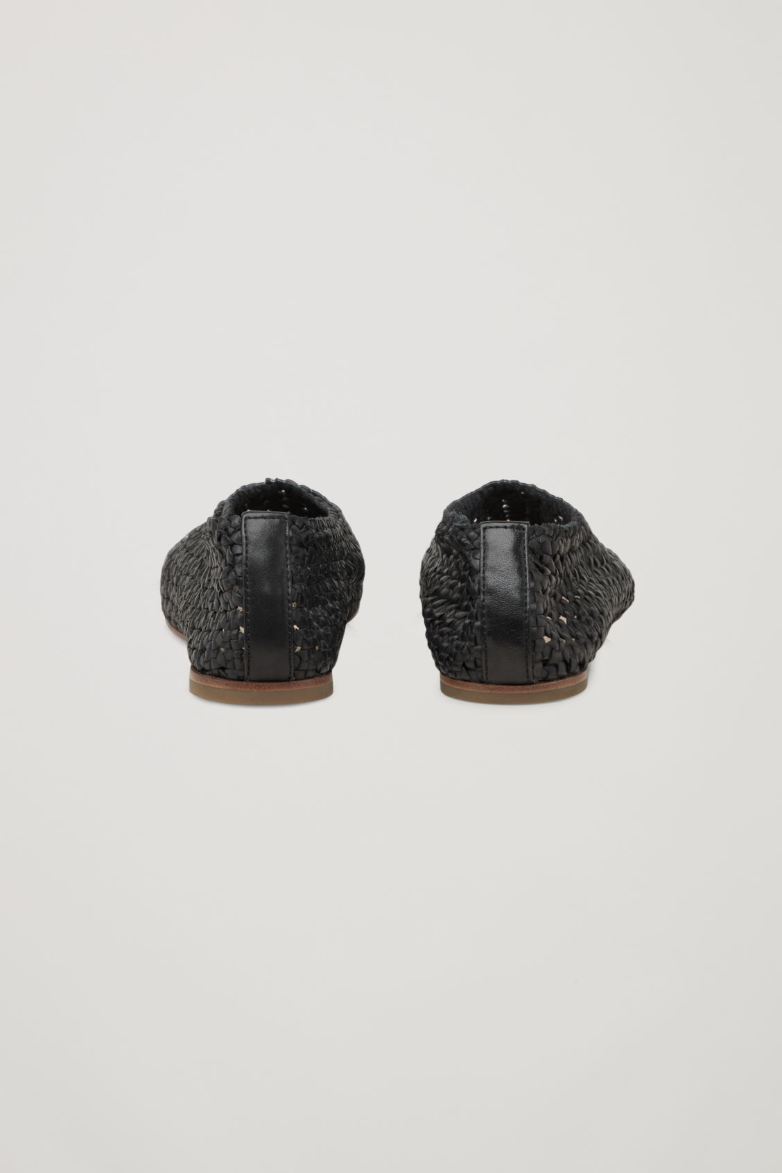 Side image of Cos braided leather slip-on shoes in black