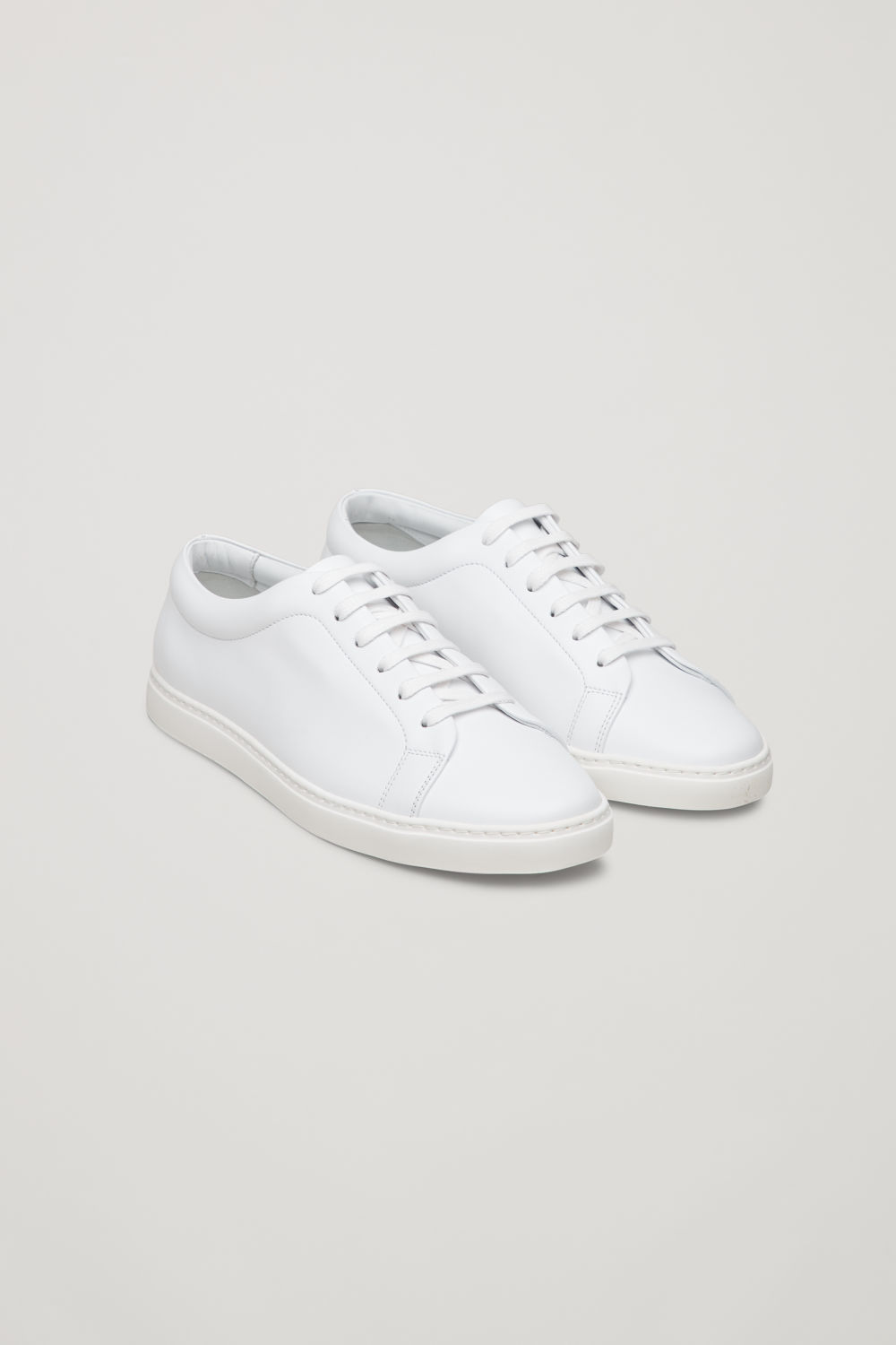 Front image of Cos slim-sole lace-up sneakers in white