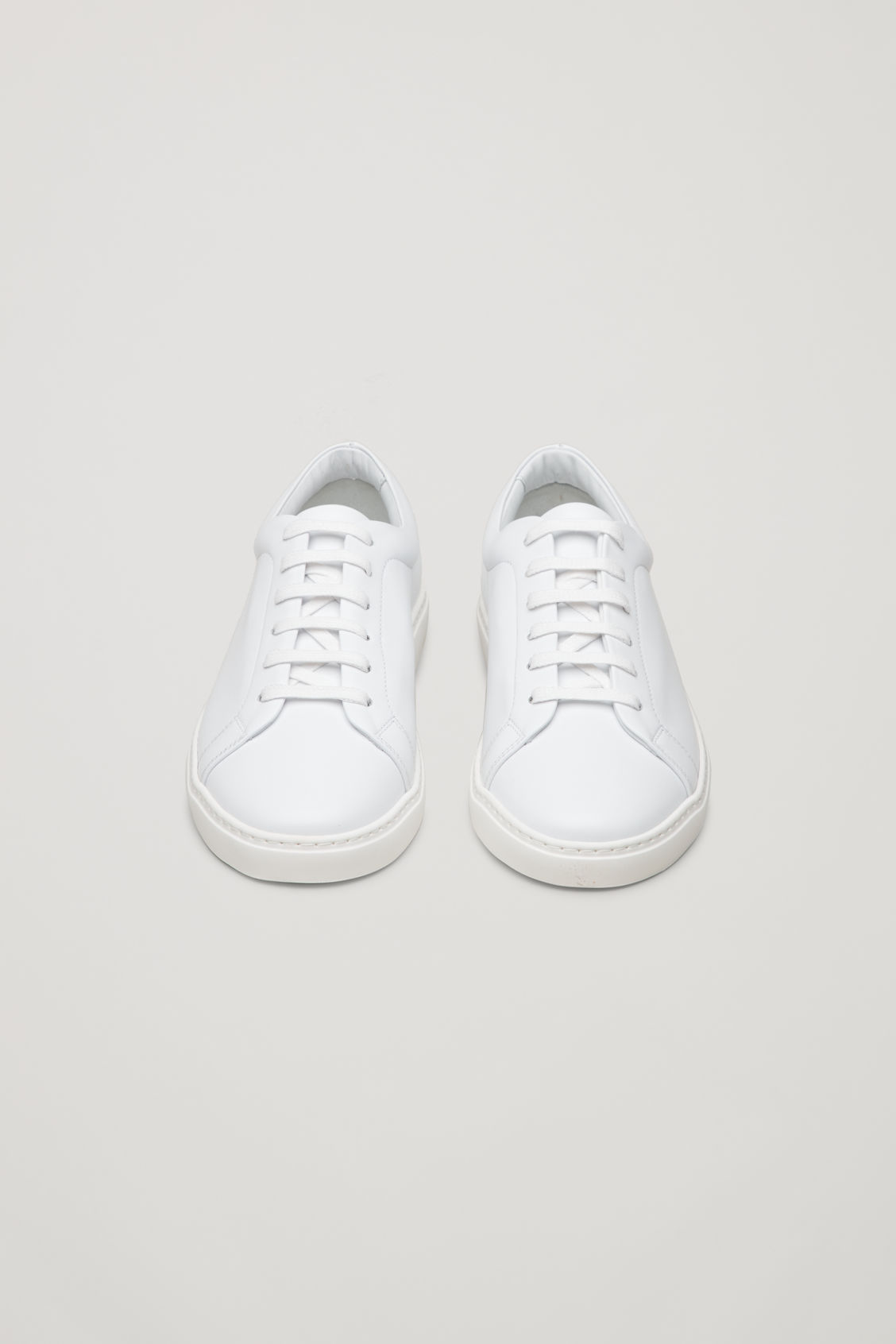 Side image of Cos slim-sole lace-up sneakers in white