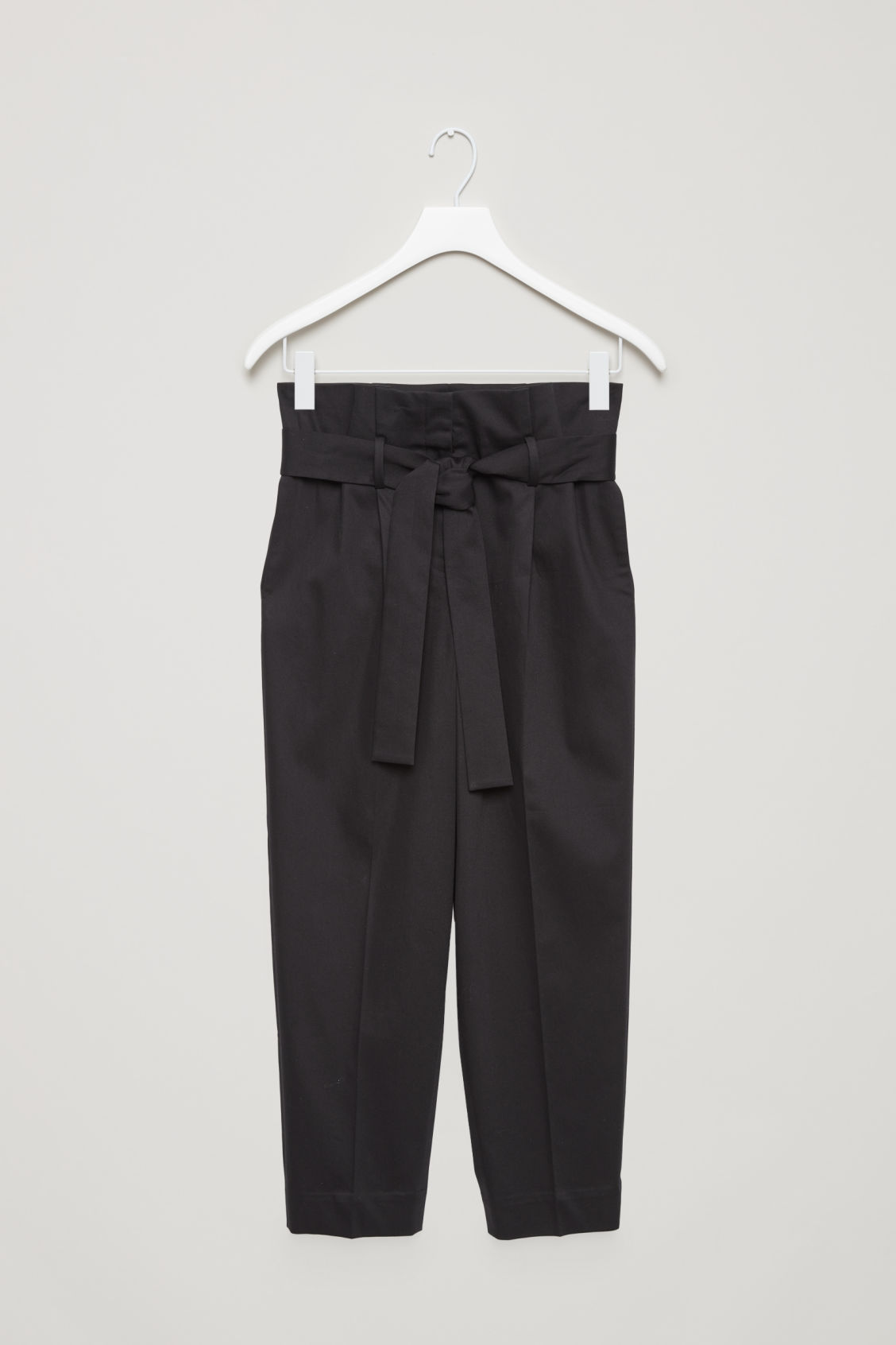 Front image of Cos trousers with waist tie in black