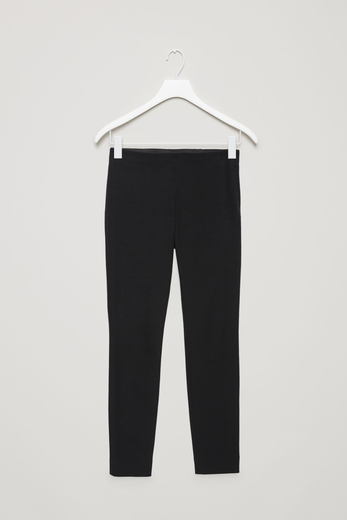 Front image of Cos slim-fit trousers in black