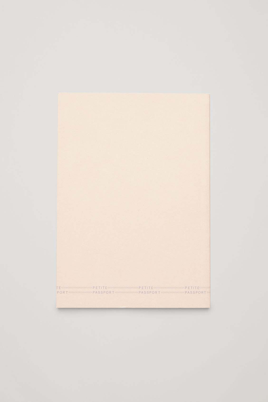 Side image of Cos petite passport: the new york guide in white