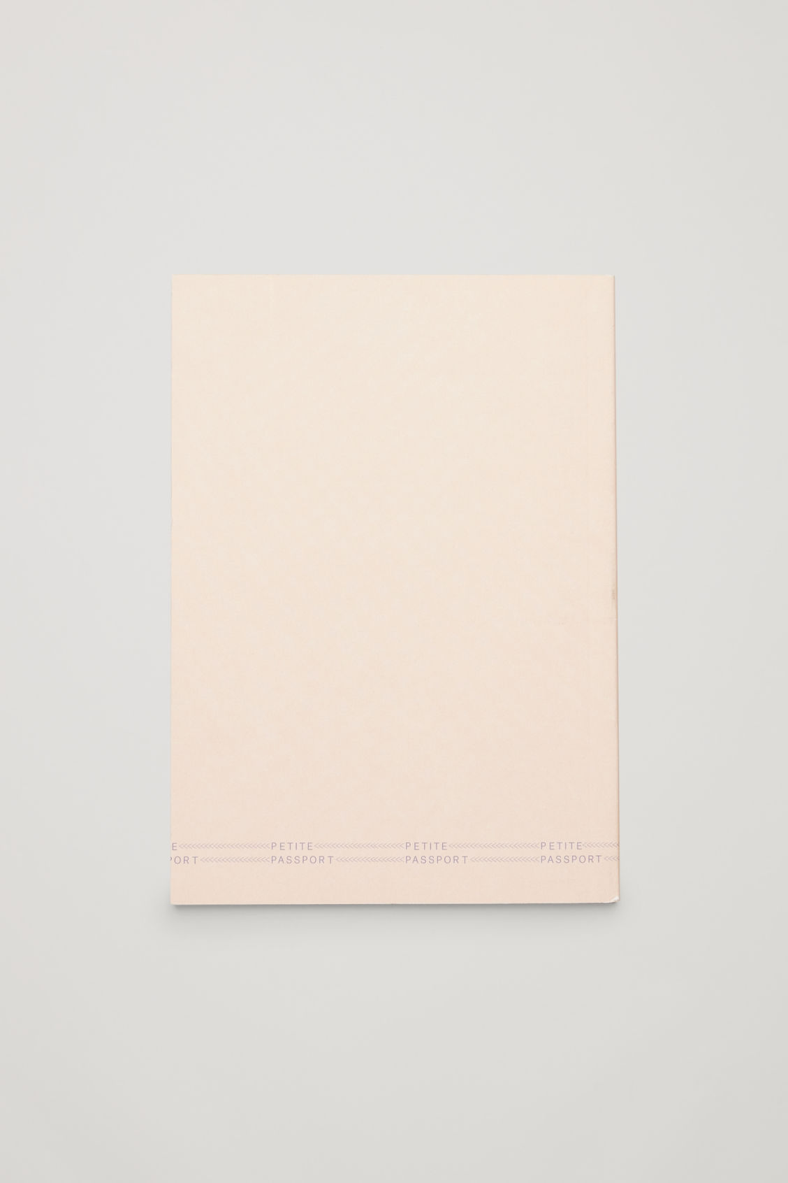 Side image of Cos petite passport: the berlin guide in white
