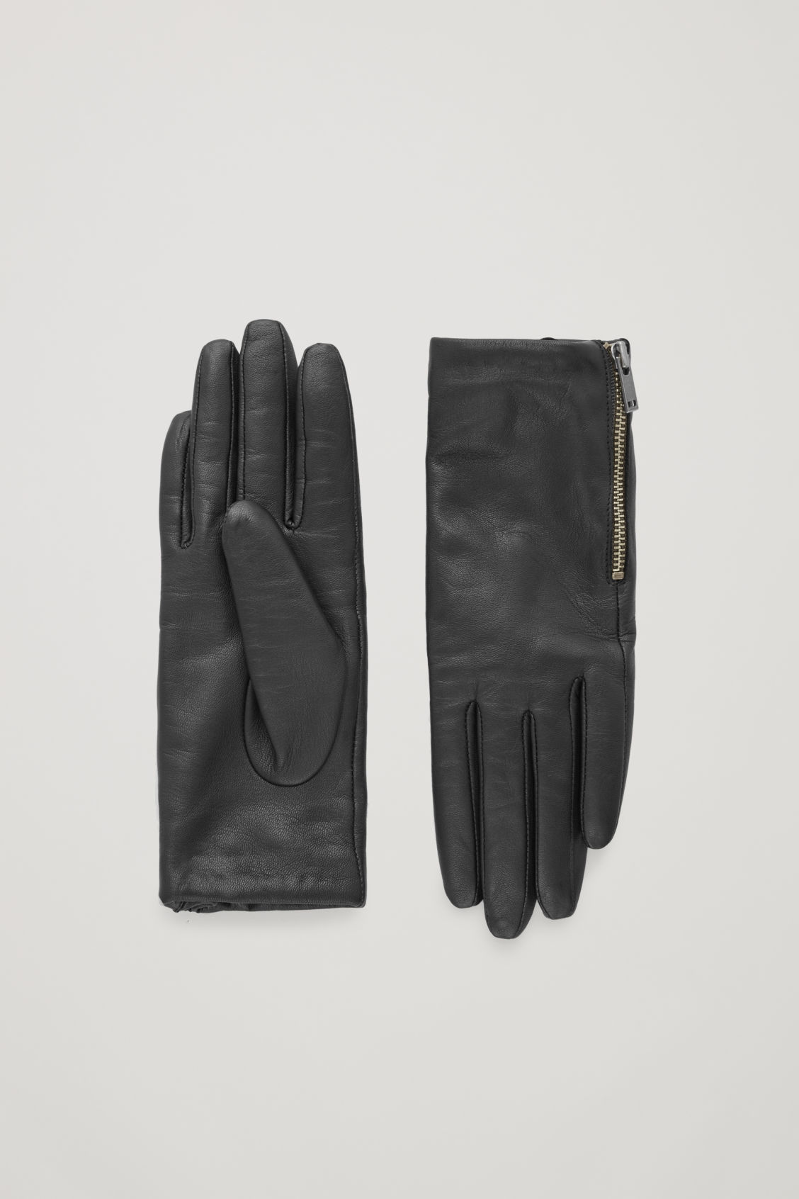 Front image of Cos zip leather gloves  in black