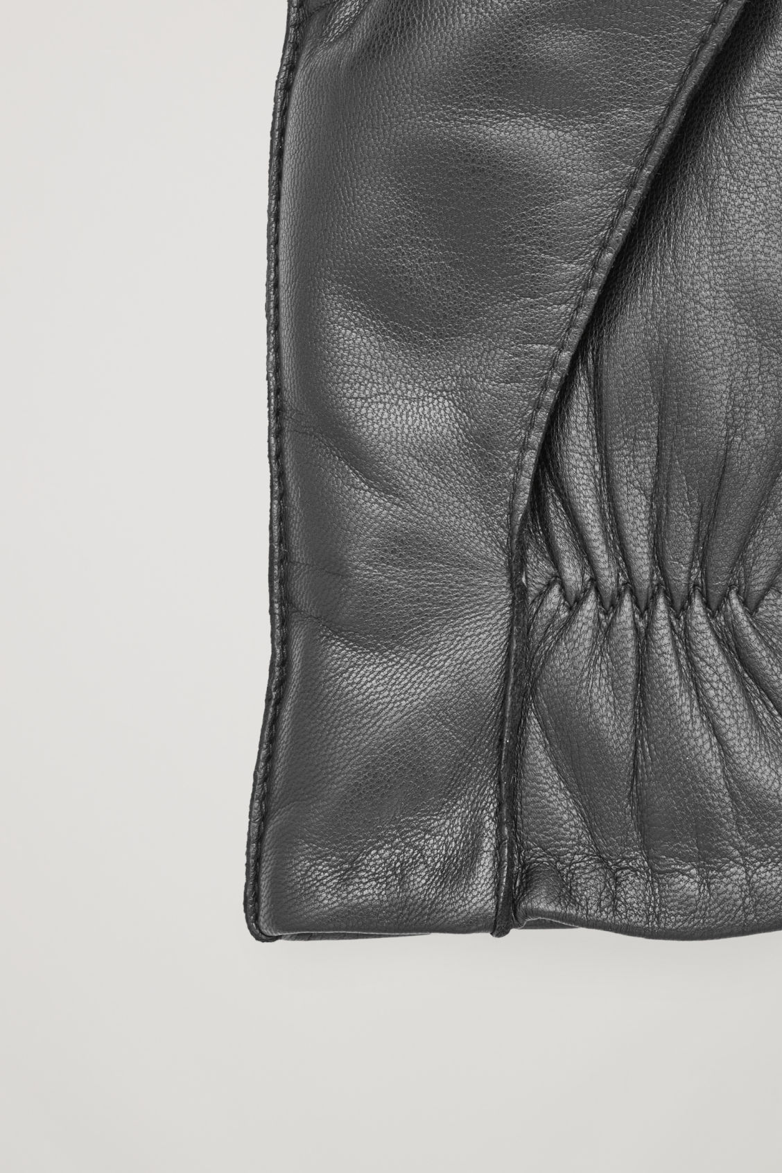 Side image of Cos padded leather mittens  in black