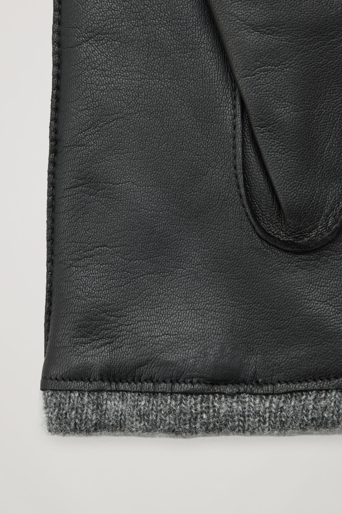Side image of Cos leather mittens  in black