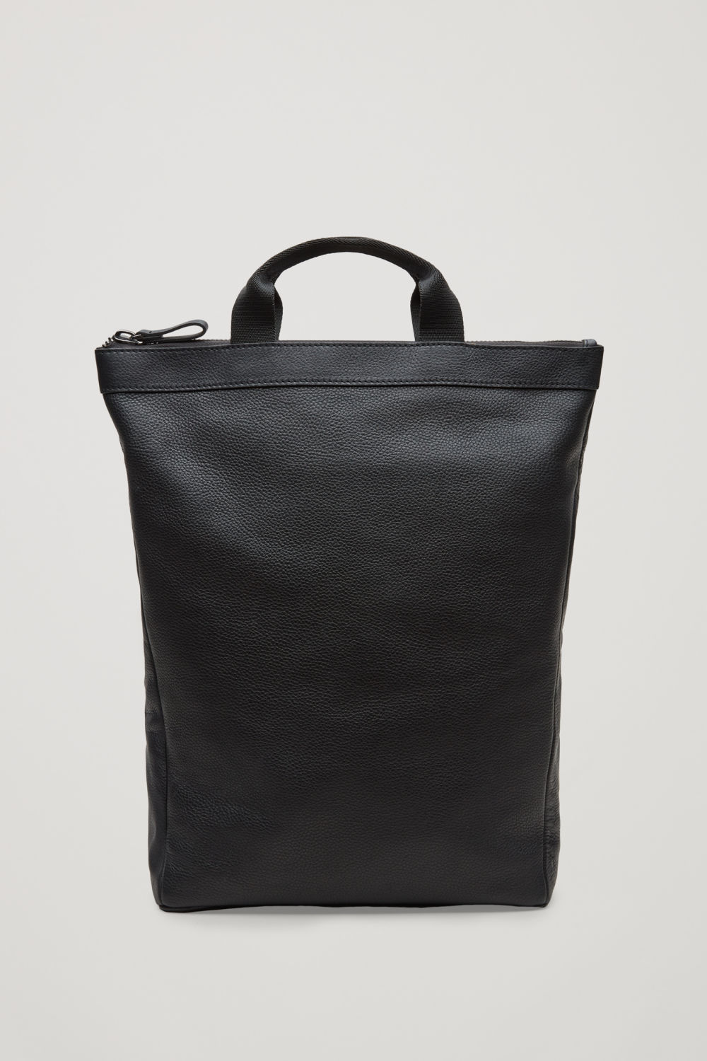 Front image of Cos leather tote backpack in black