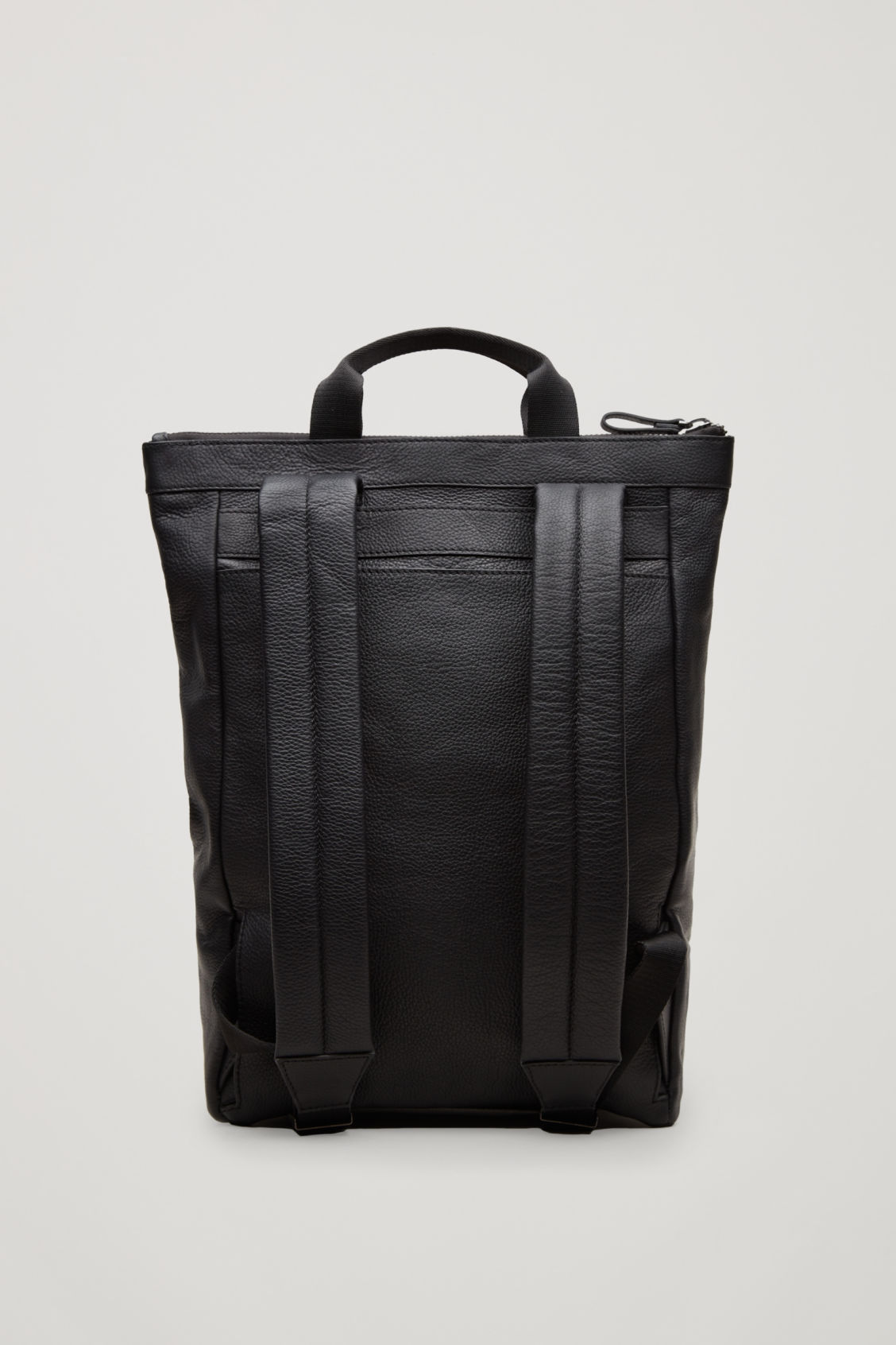 Side image of Cos leather tote backpack in black