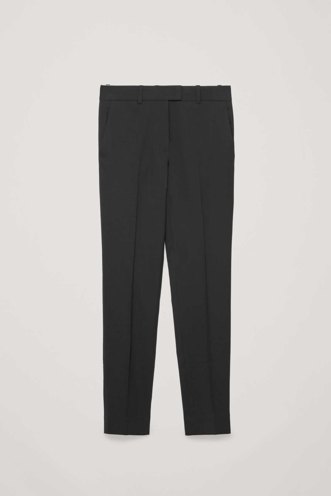 Front image of Cos tailored wool trousers in black