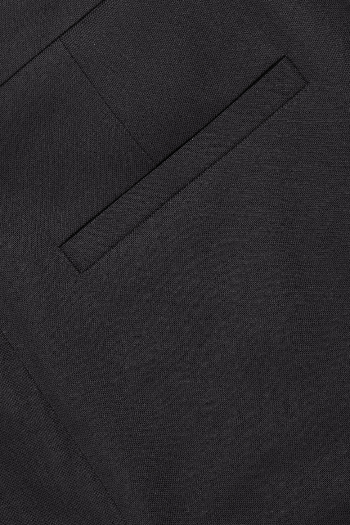 Side image of Cos tailored wool trousers in black