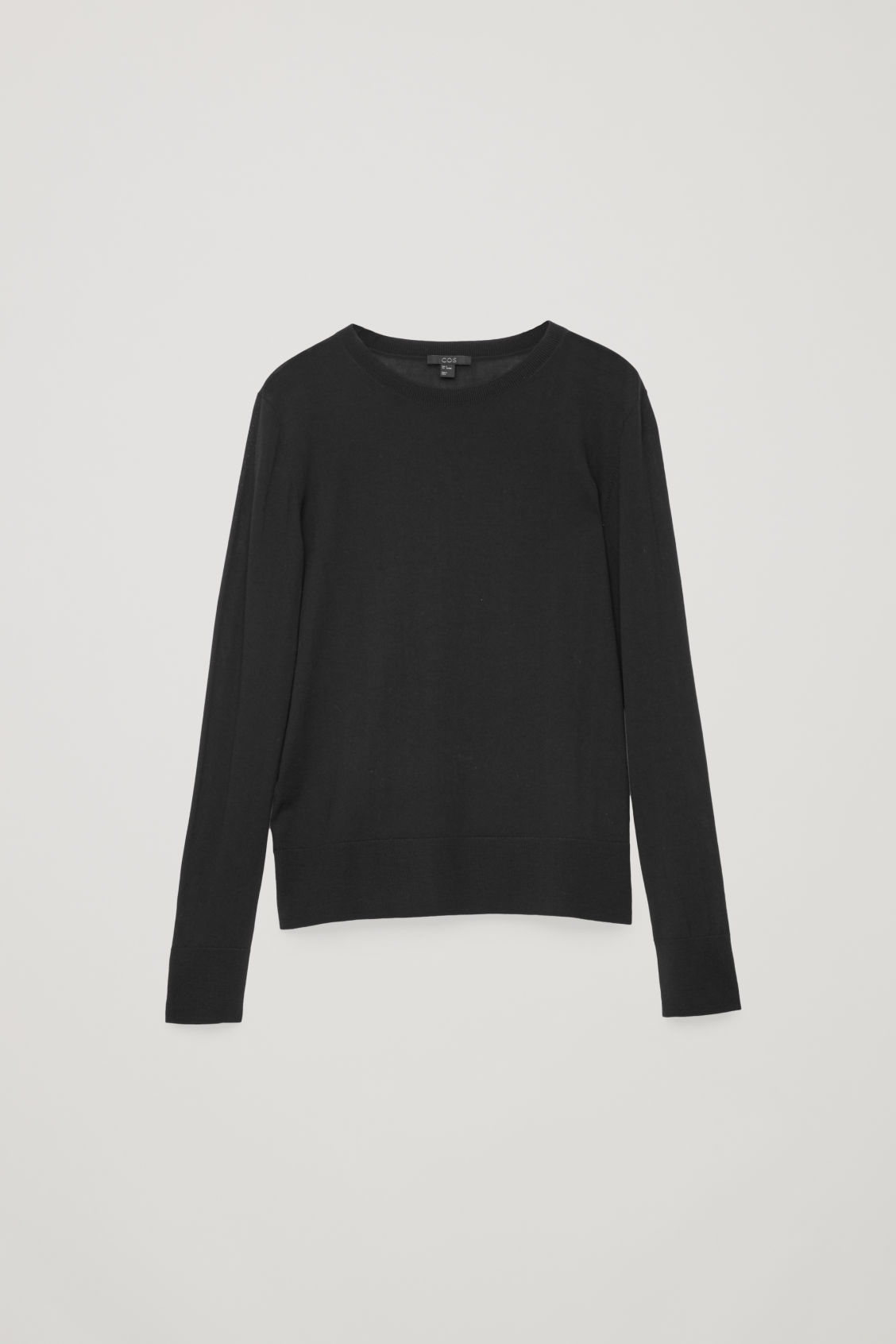 Front image of Cos round-neck merino jumper in black