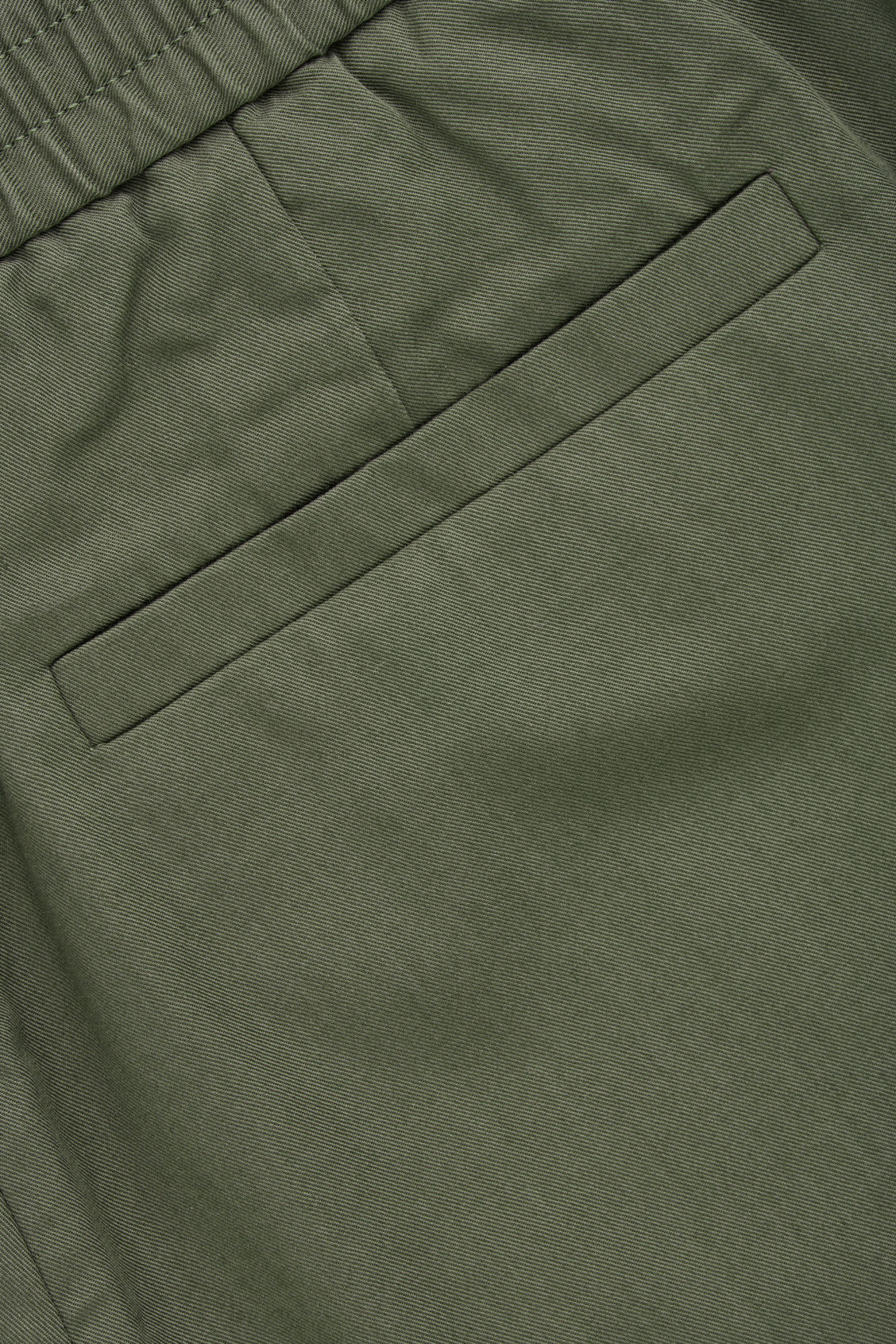 Side image of Cos tailored trousers with elastic waist in green
