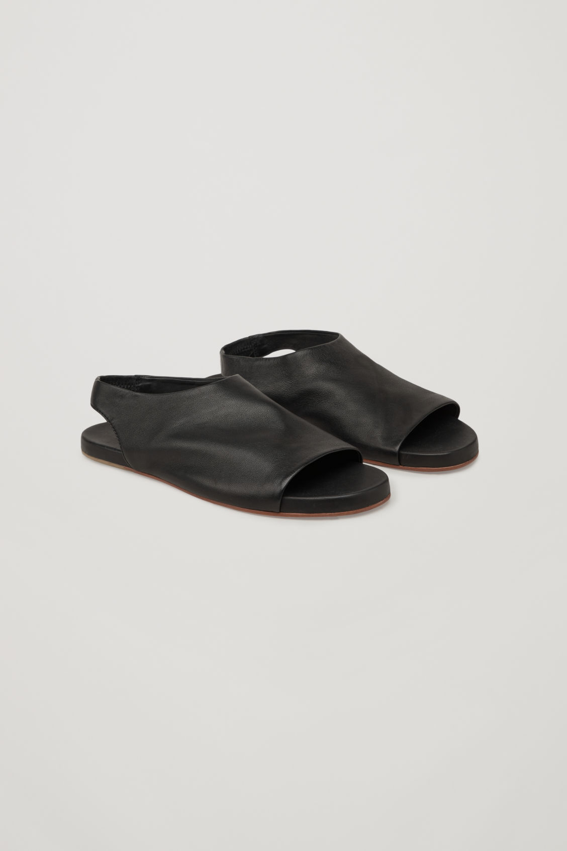 Front image of Cos sandals with elastic detail in black