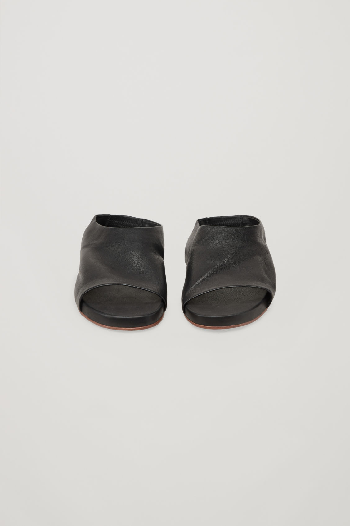 Side image of Cos sandals with elastic detail in black