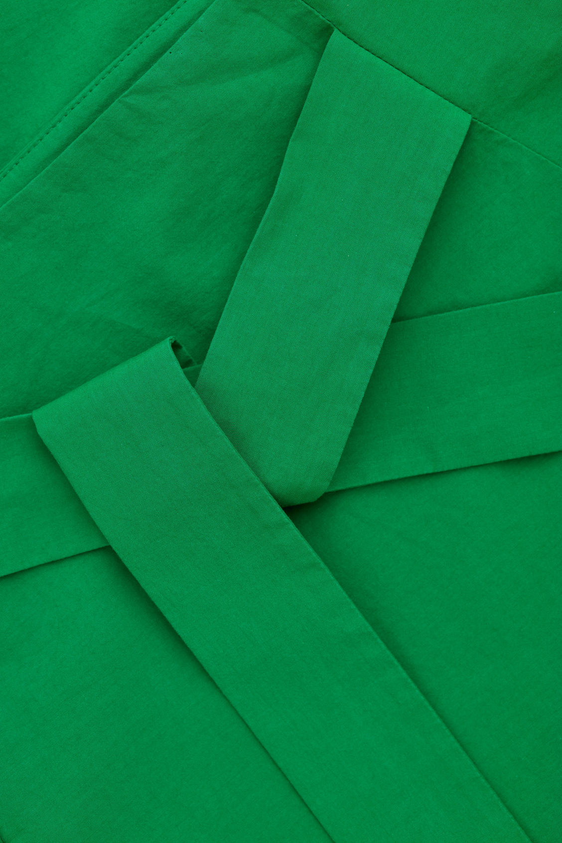 Side image of Cos a-line wrap-over skirt in green