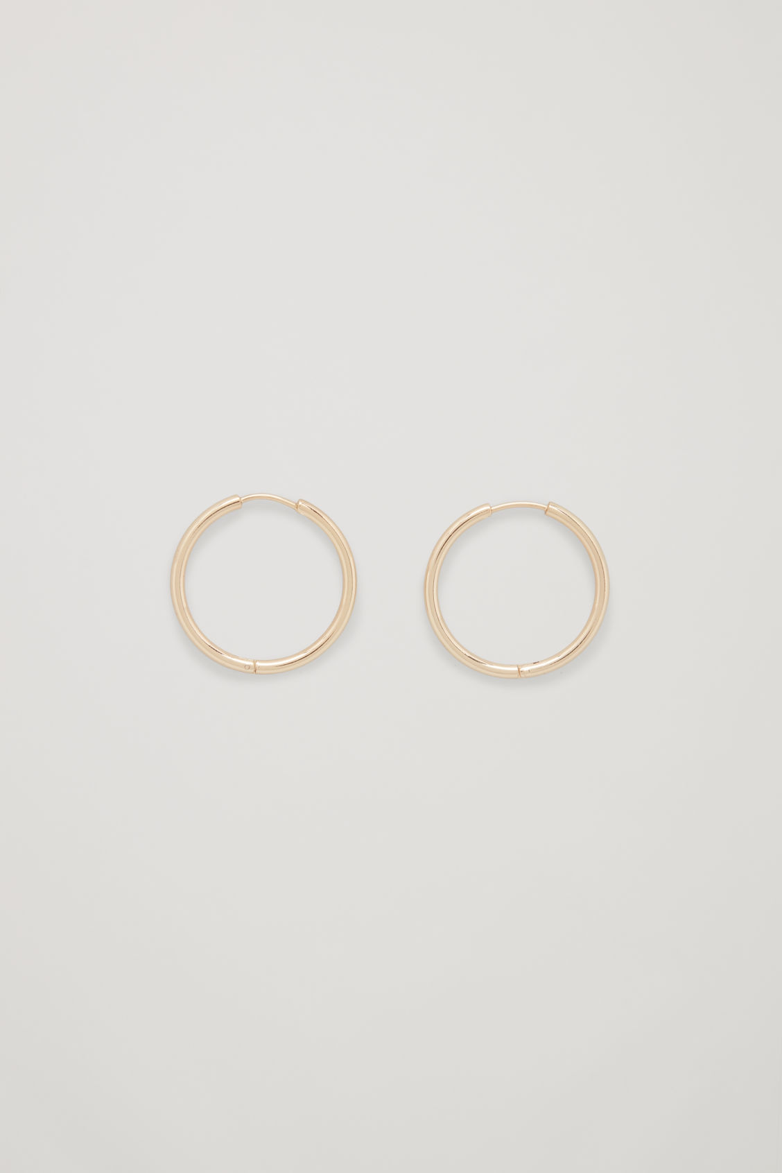 Front image of Cos mid-hoop earrings in gold
