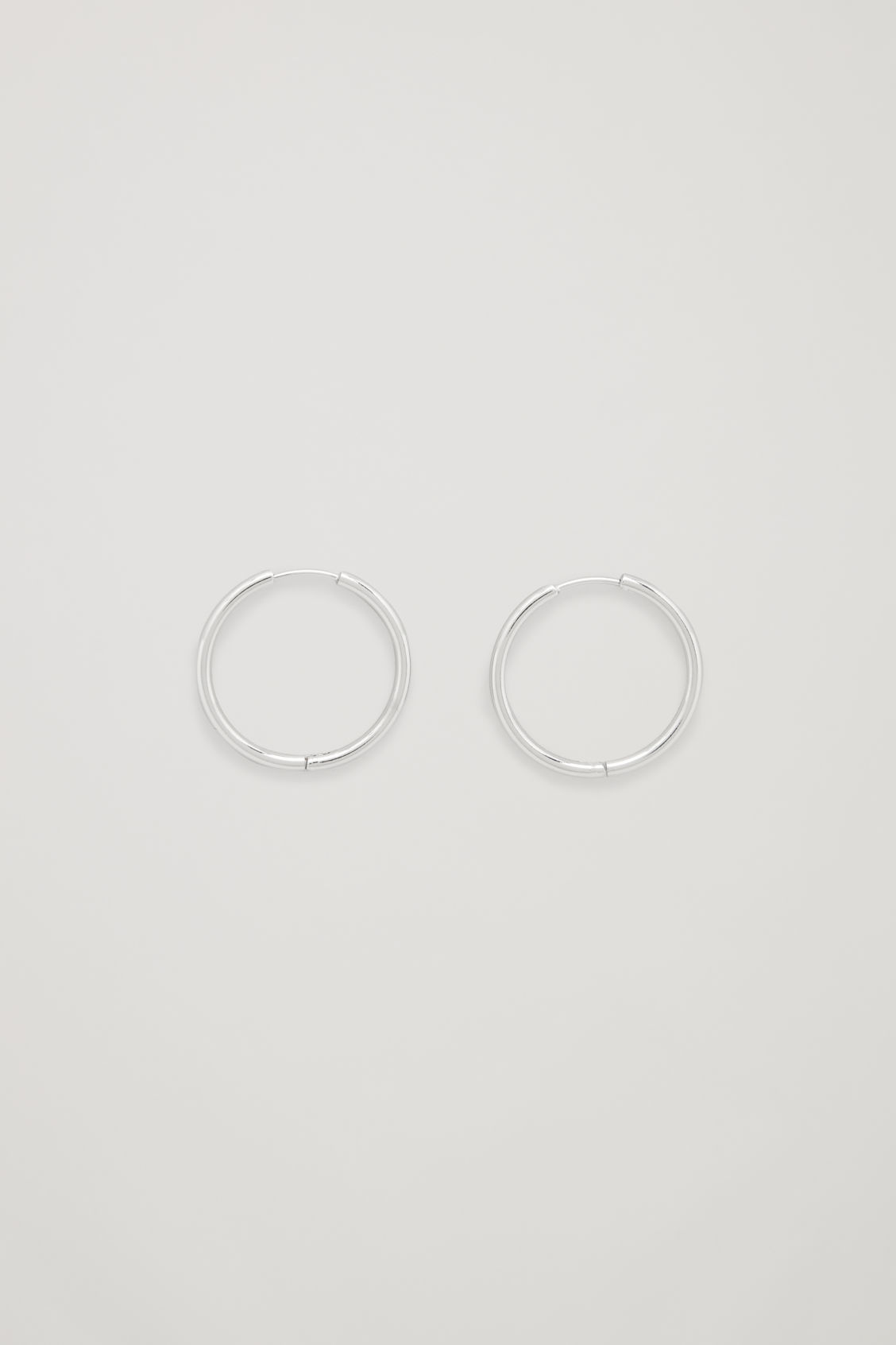 Front image of Cos mid-hoop earrings in silver