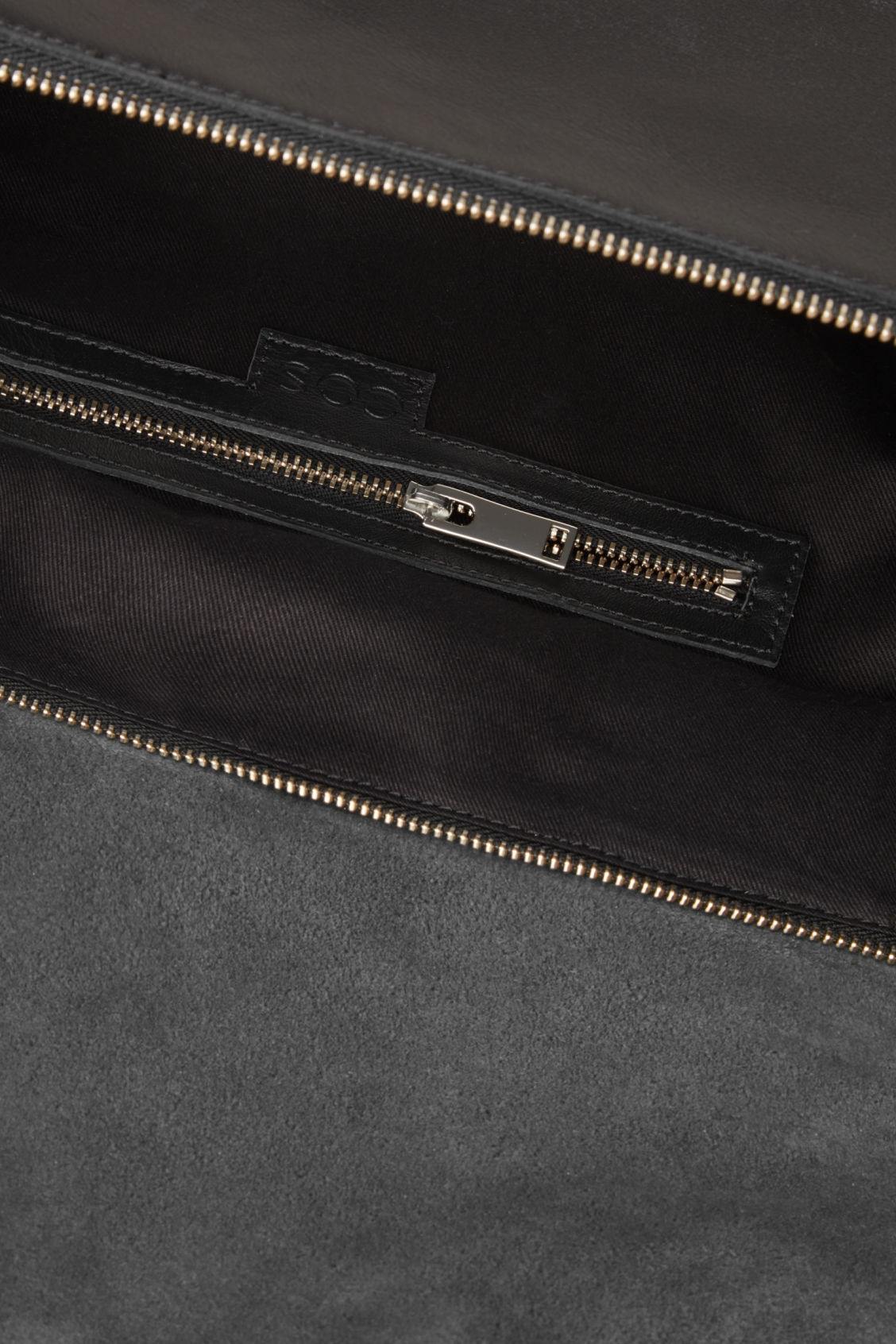 Side image of Cos leather tote bag with shoulder strap in black