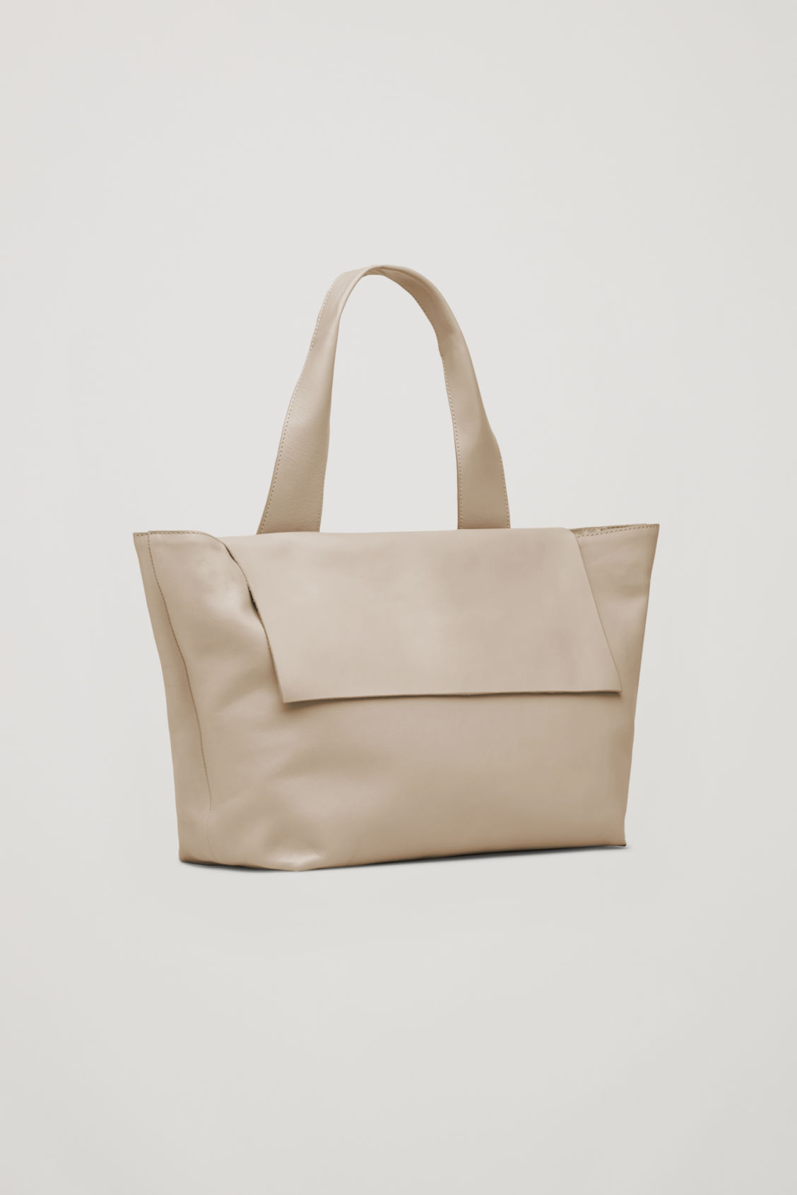 Side image of Cos leather tote bag with shoulder strap in beige