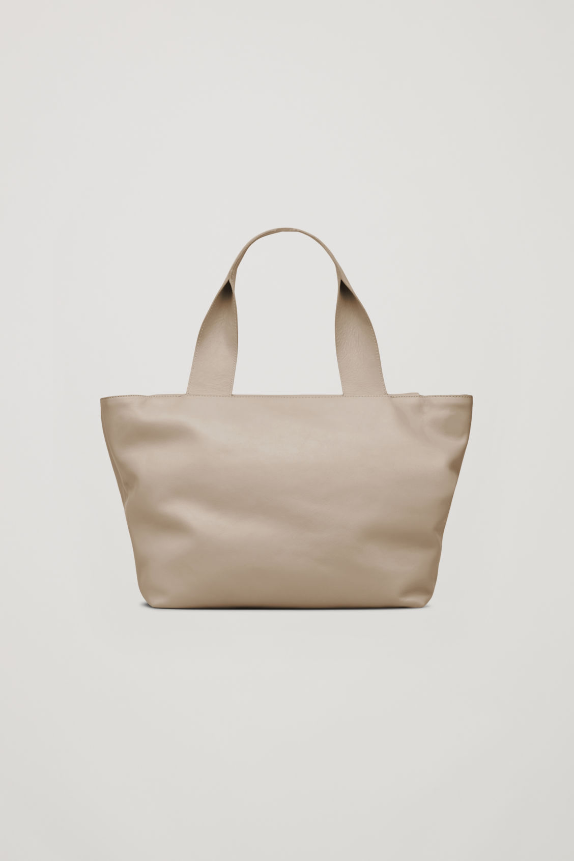 Side image of Cos leather tote bag with strap in beige
