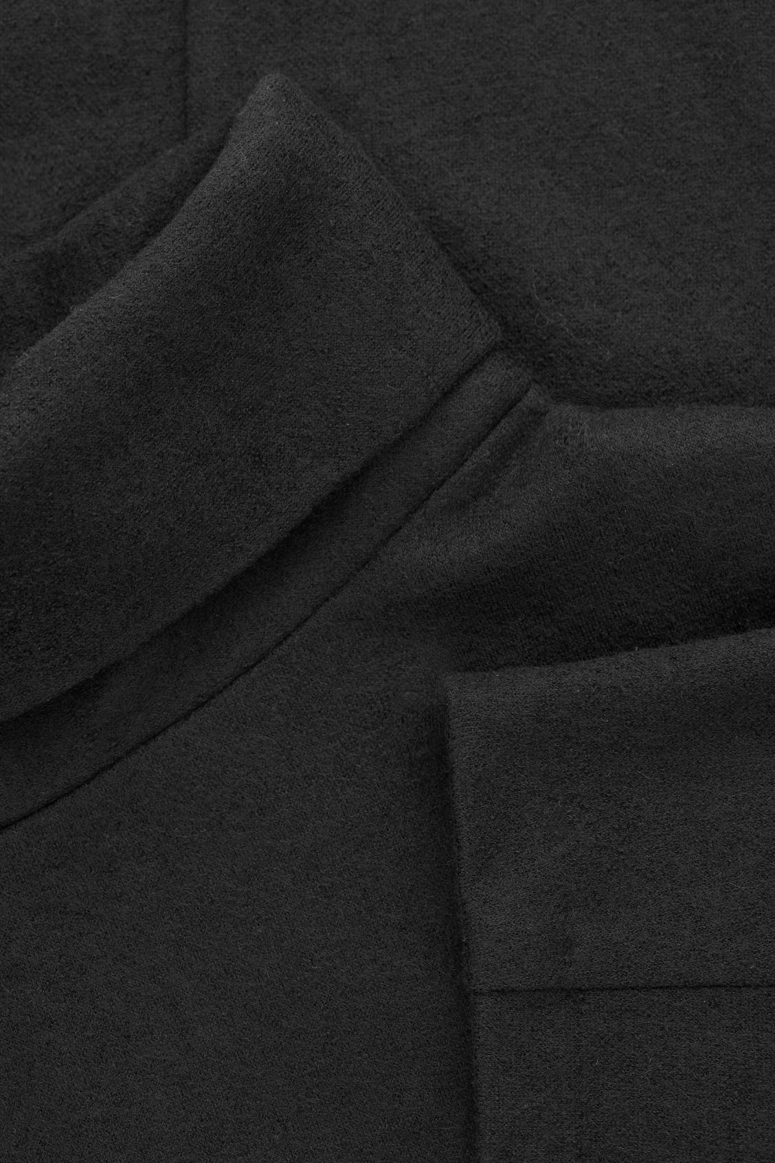 Side image of Cos jersey wool top with cocoon sleeves  in black
