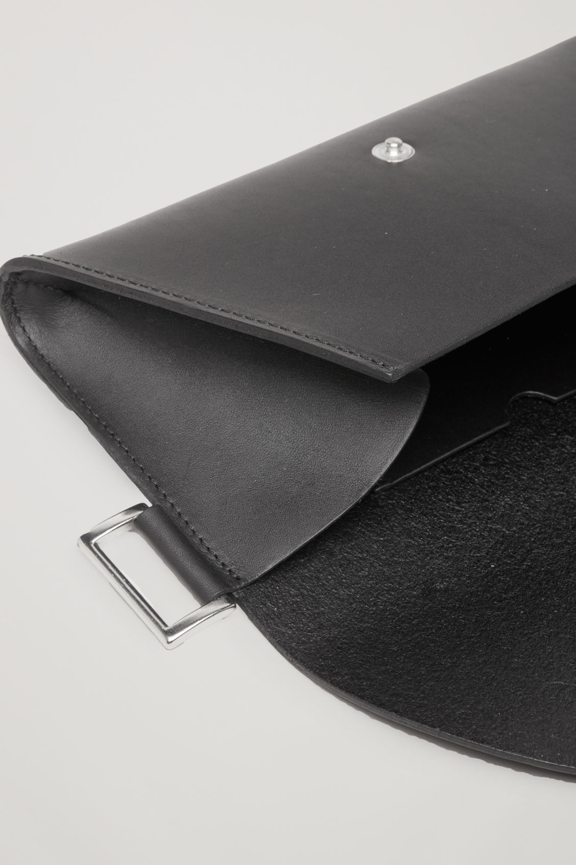 Side image of Cos belted pocket bag in black