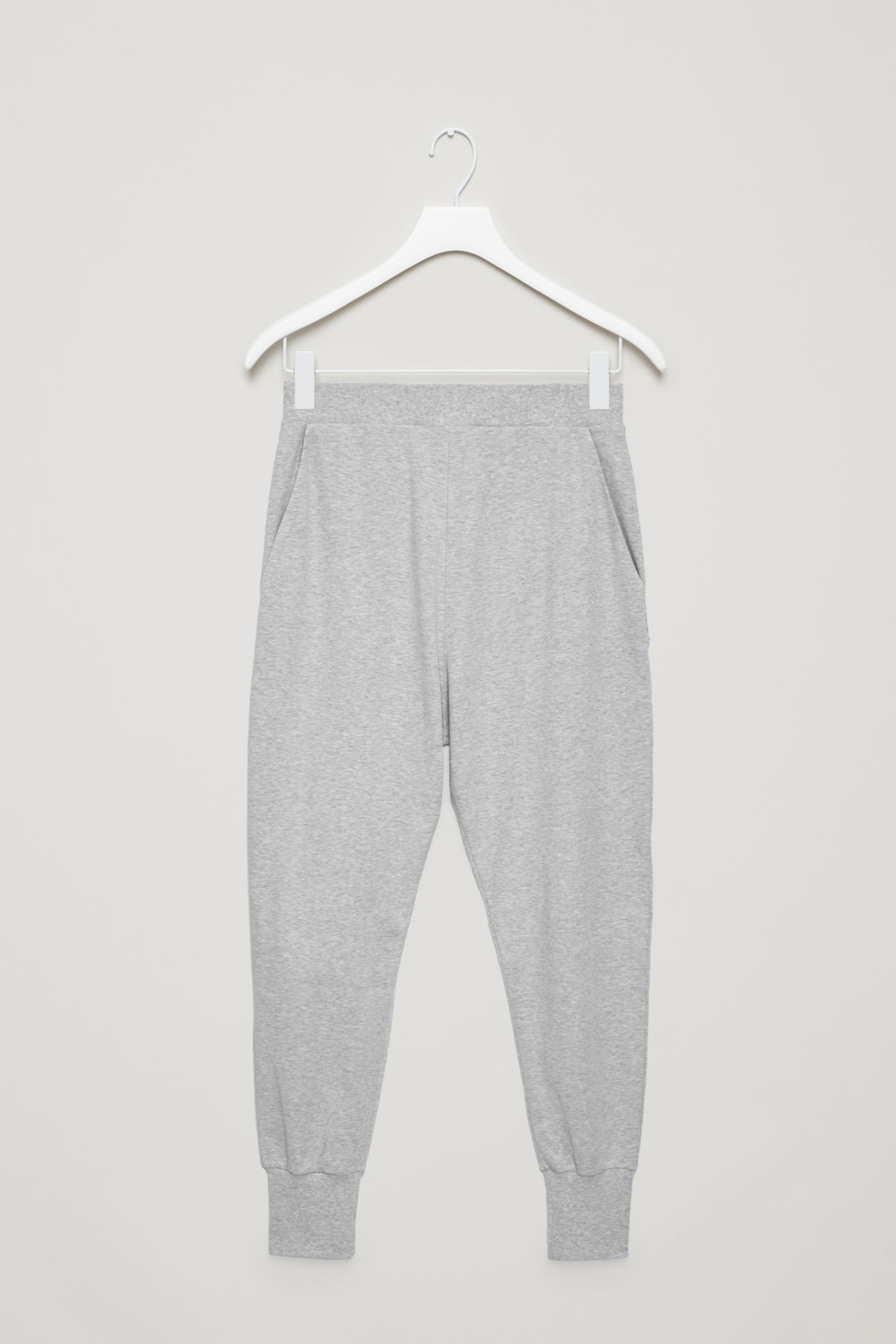 Front image of Cos tapered jersey trousers in grey
