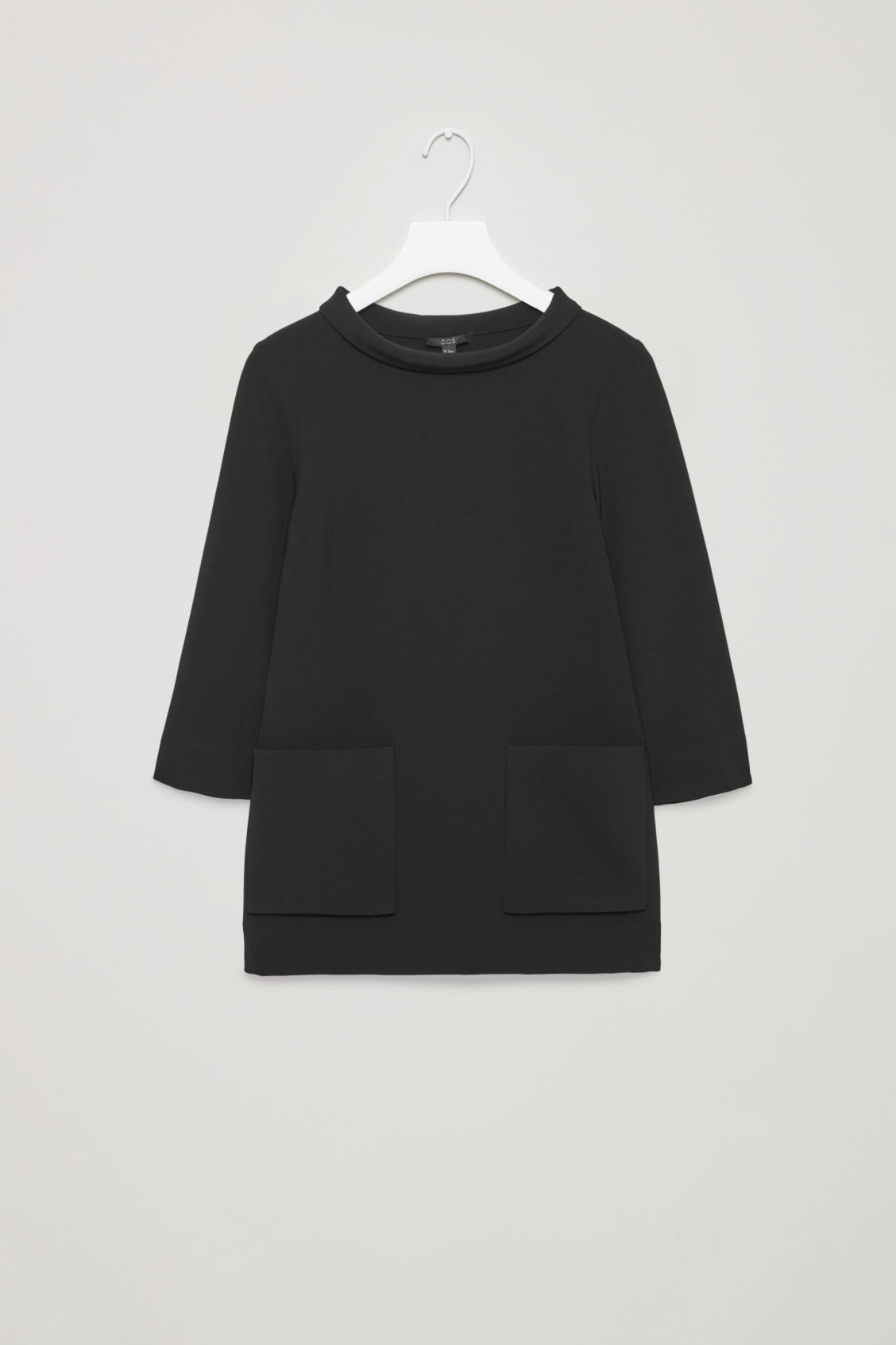 Front image of Cos top with folded collar  in black