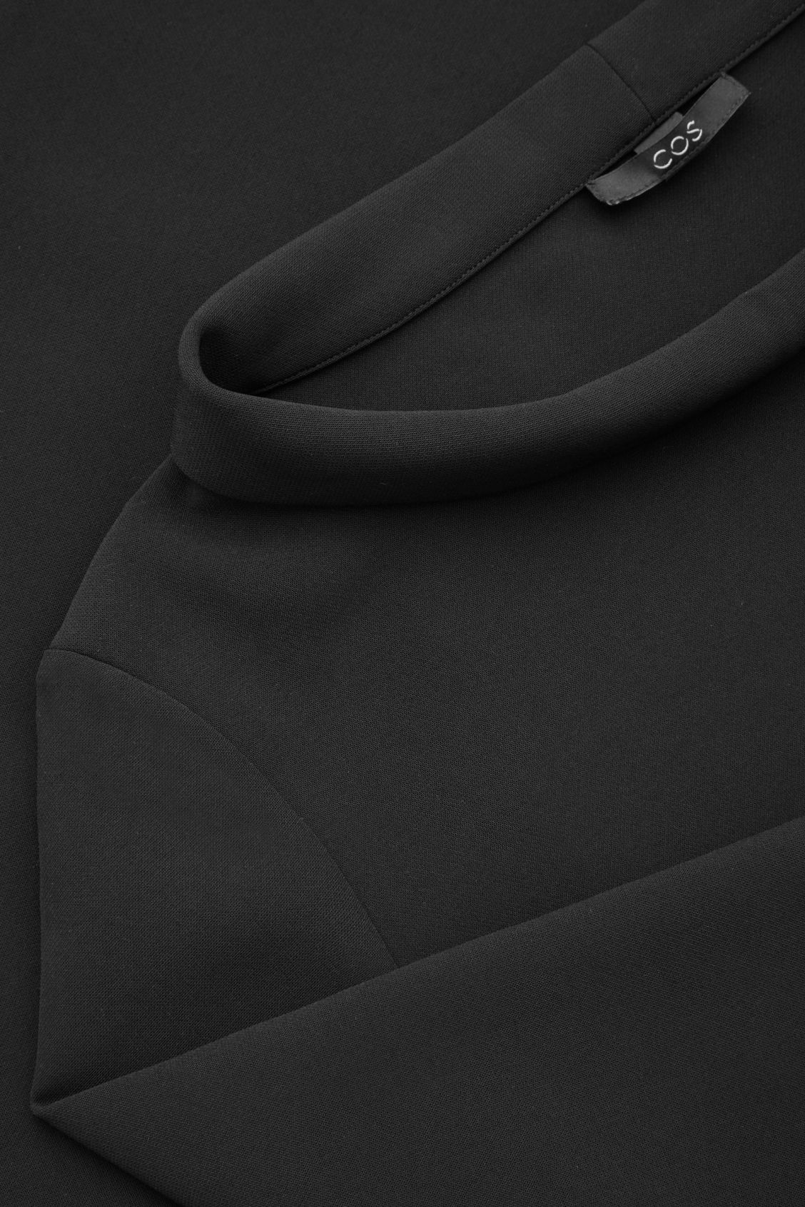 Side image of Cos top with folded collar  in black