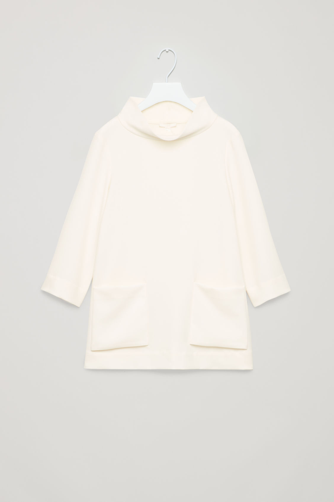 Front image of Cos top with folded collar  in white