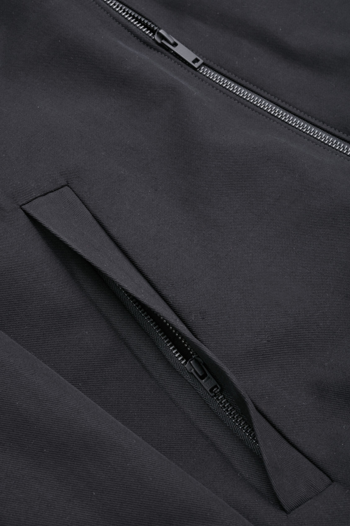 Side image of Cos bomber jacket with zipped pockets  in black