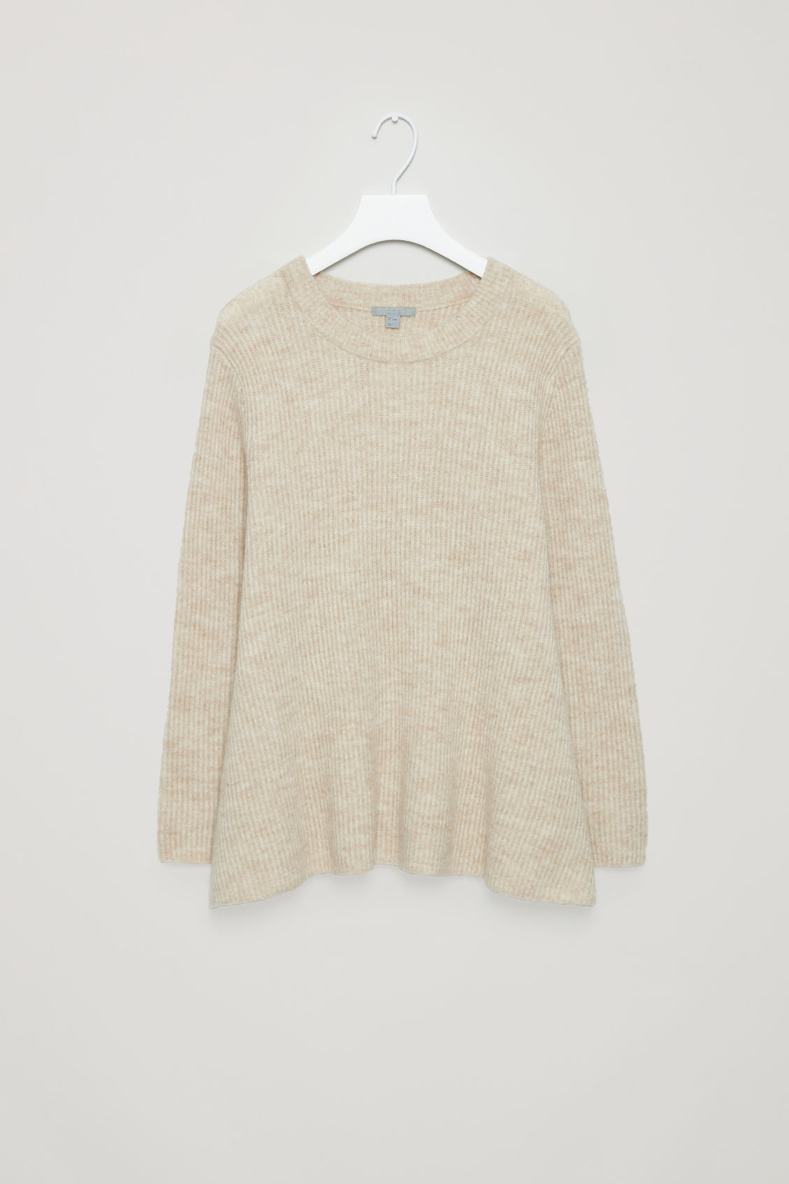 Front image of Cos waisted peplum jumper  in beige