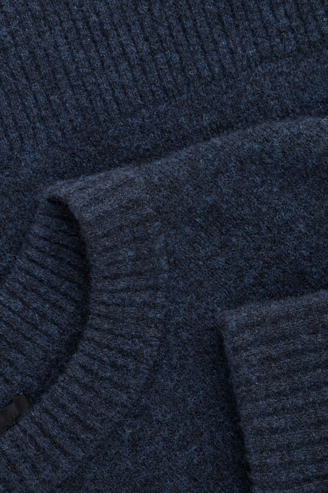 Side image of Cos alpaca and wool jumper  in blue