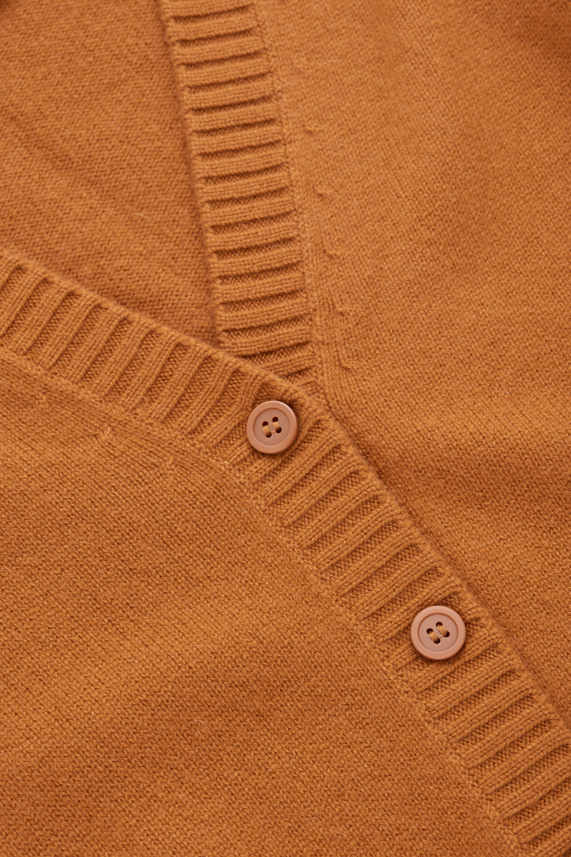 Side image of Cos relaxed cashmere cardigan  in orange