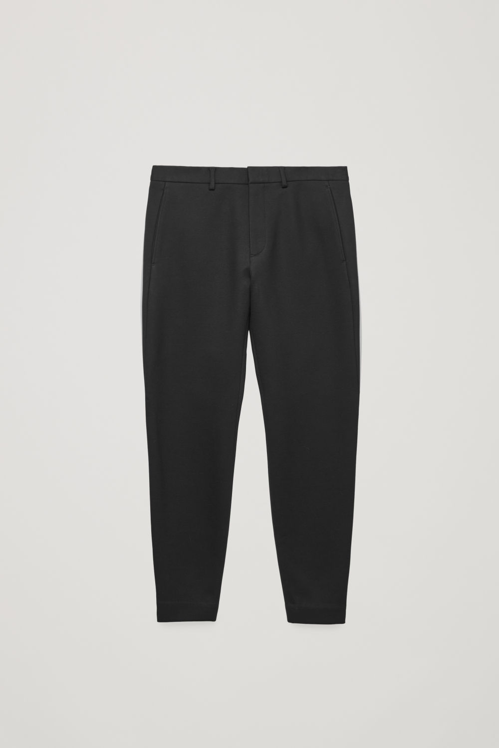Front image of Cos zip-cuff jersey trousers in black