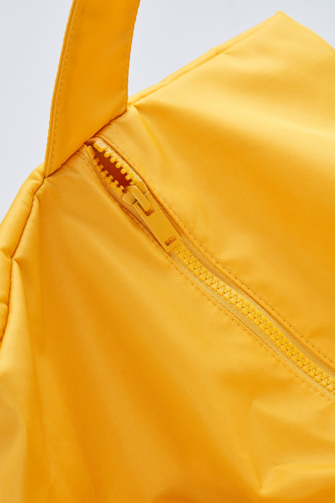 Side image of Cos collapsed tote bag in yellow