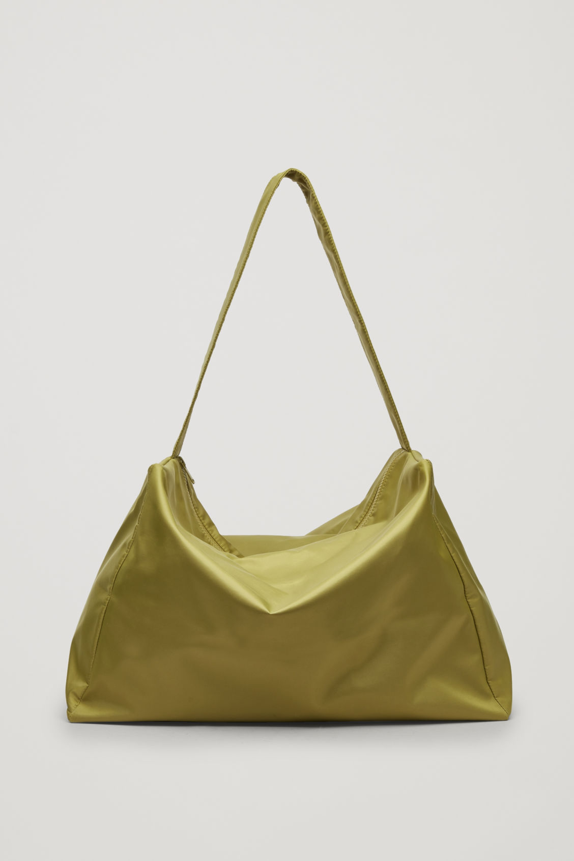 Front image of Cos collapsed technical tote bag in green