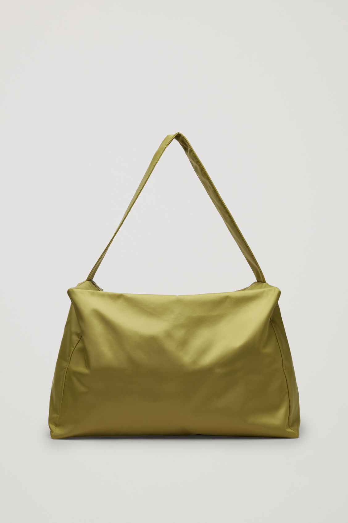 Side image of Cos collapsed technical tote bag in green