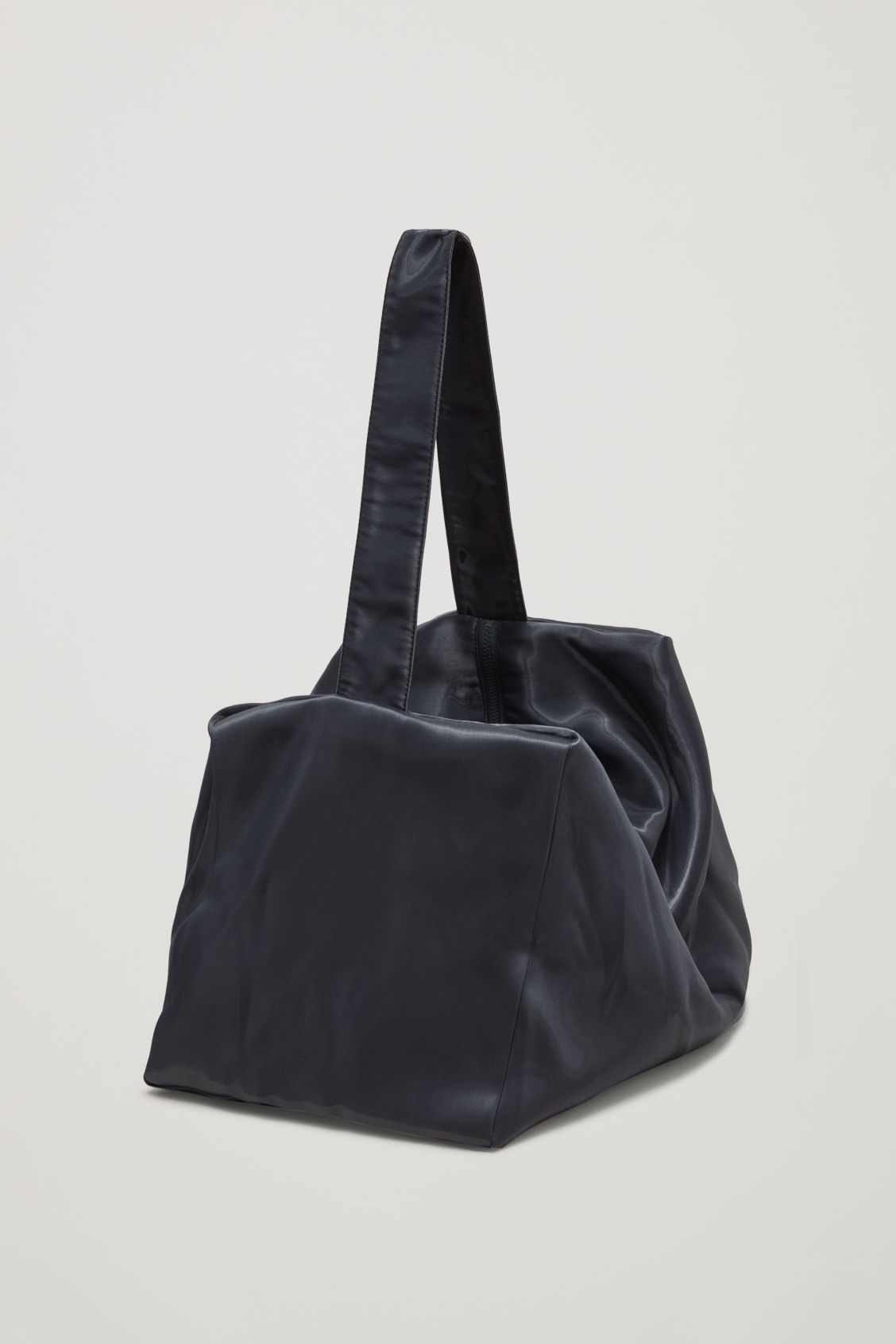 Side image of Cos collapsed tote bag in blue