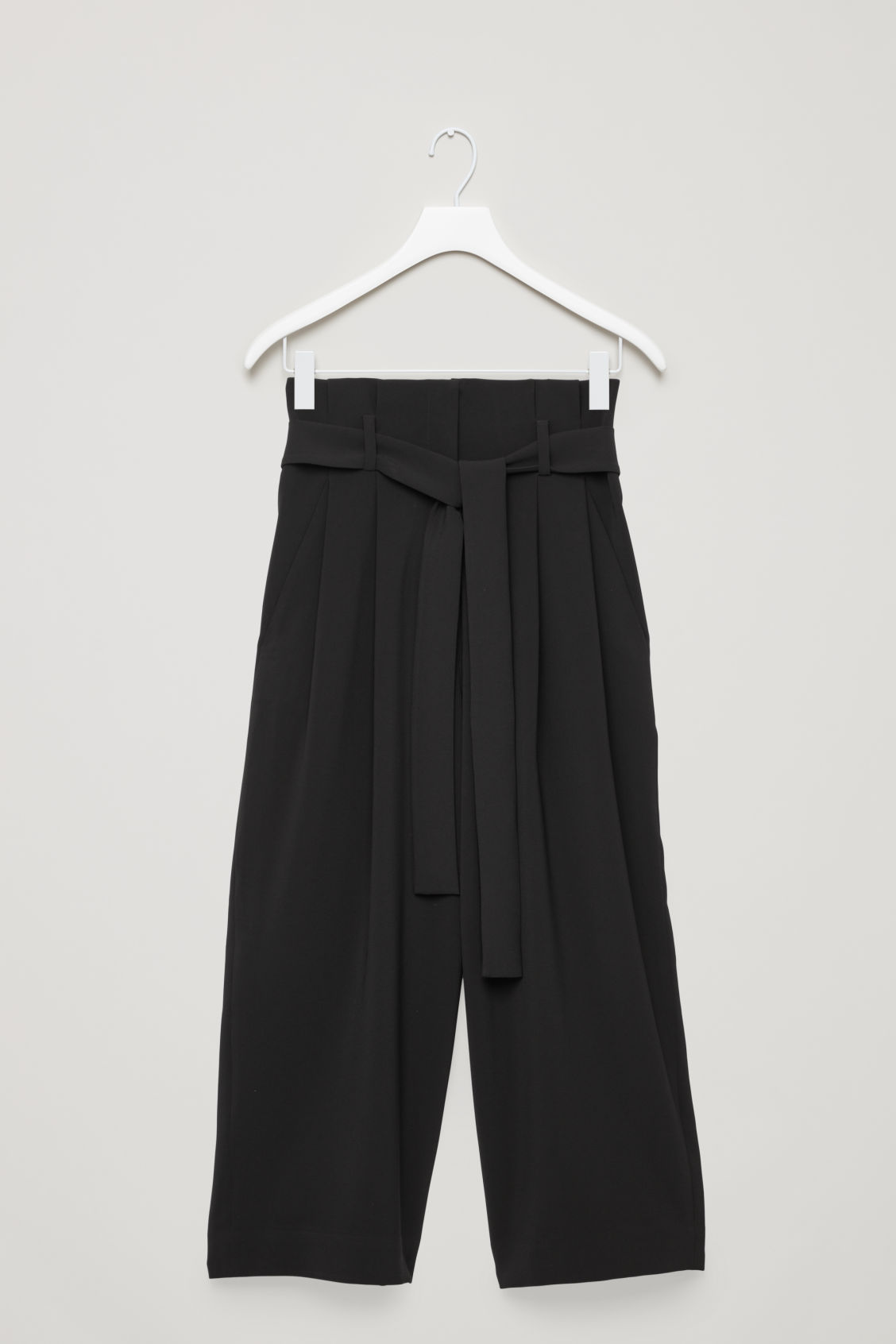 Front image of Cos belted high-waist trousers in black