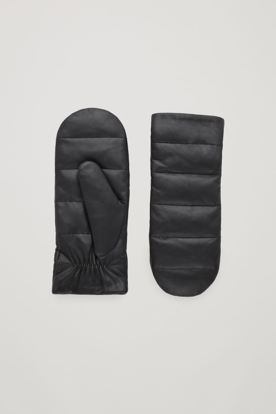Front image of Cos quilted leather mittens  in black