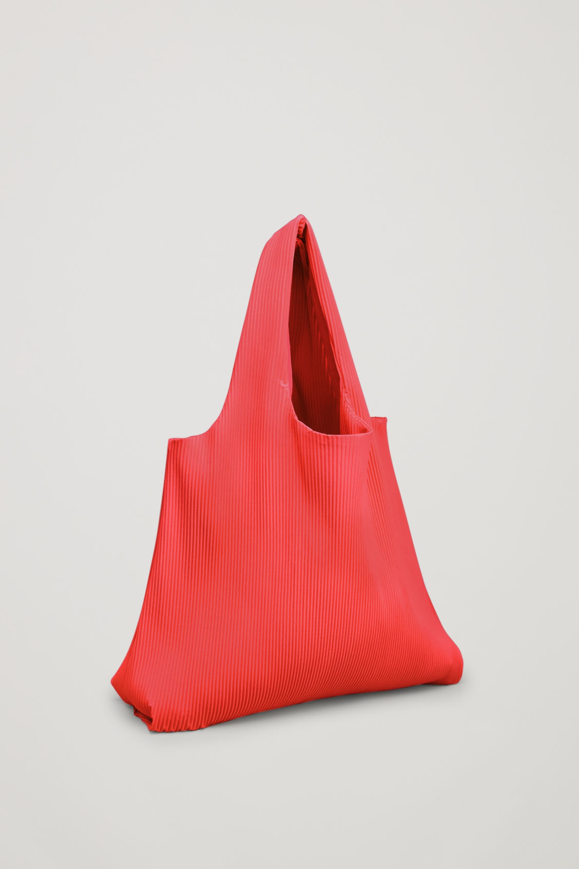 Side image of Cos pleated fabric shopper in red