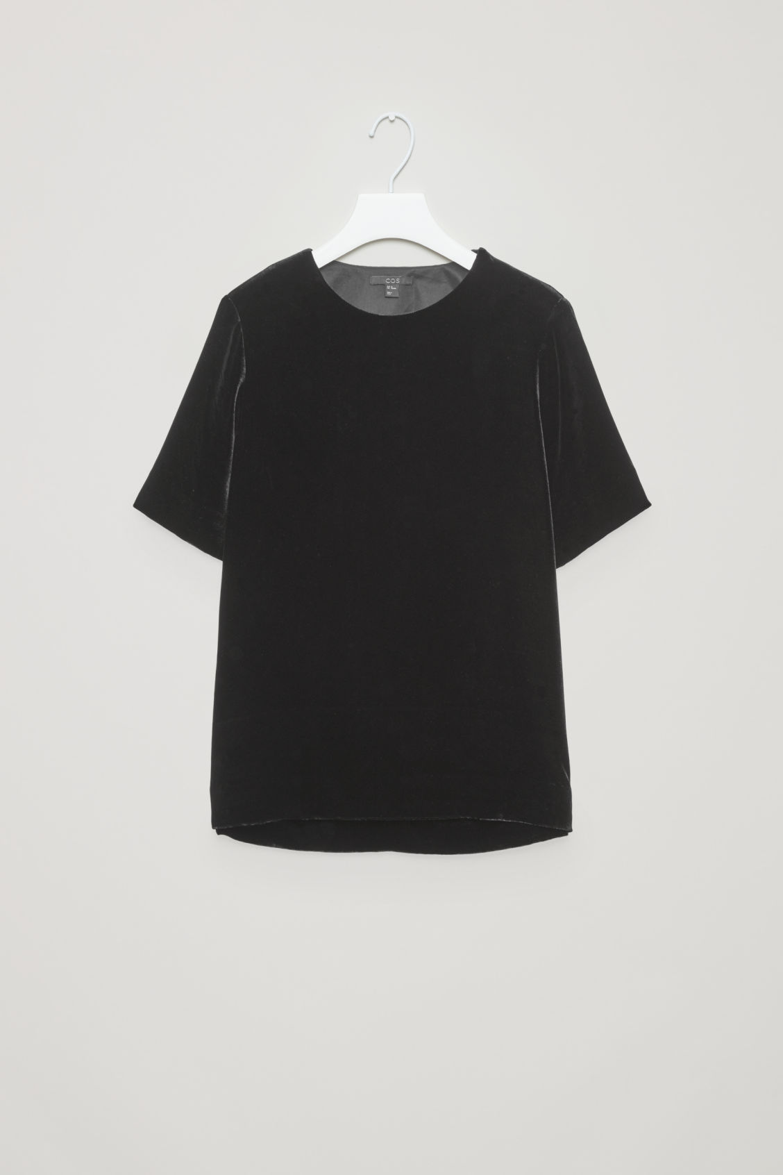 Front image of Cos velvet top with back detail in black