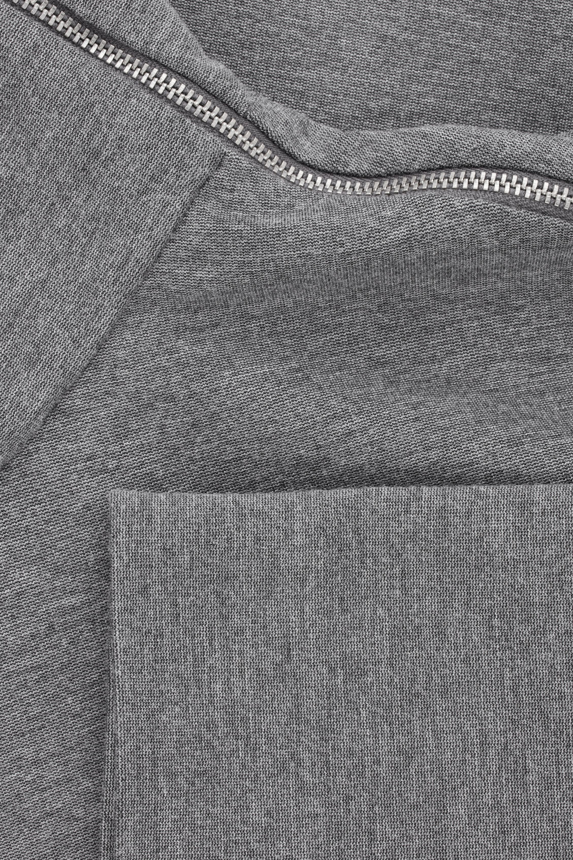 Side image of Cos jersey top with metal zip in grey