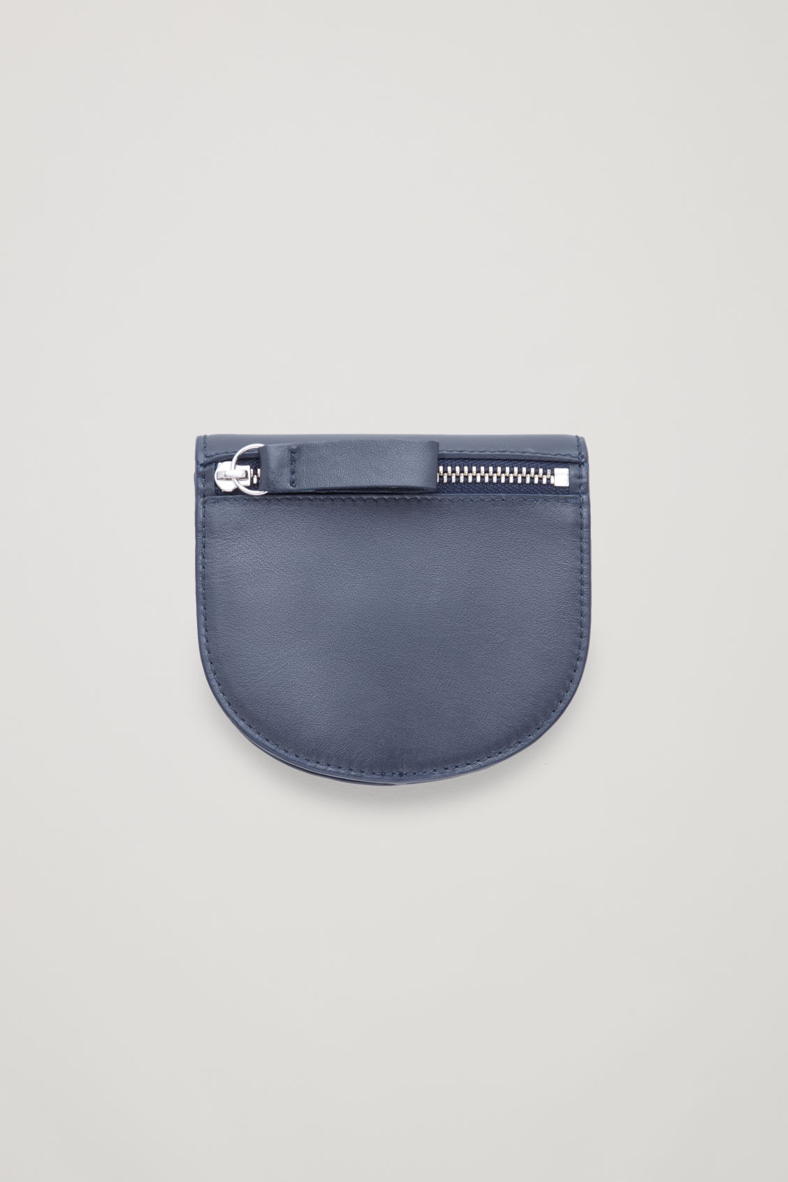 Side image of Cos half-moon leather purse in blue