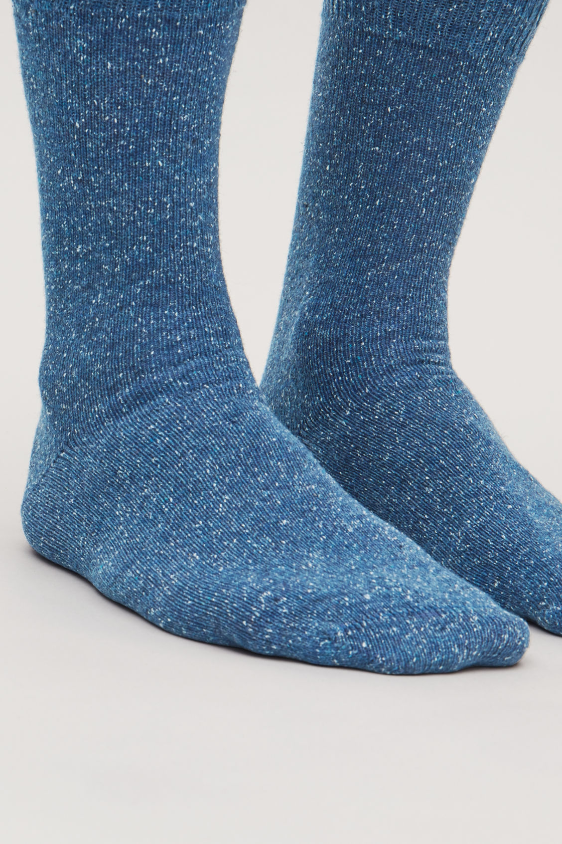Side image of Cos speckled wool socks  in blue