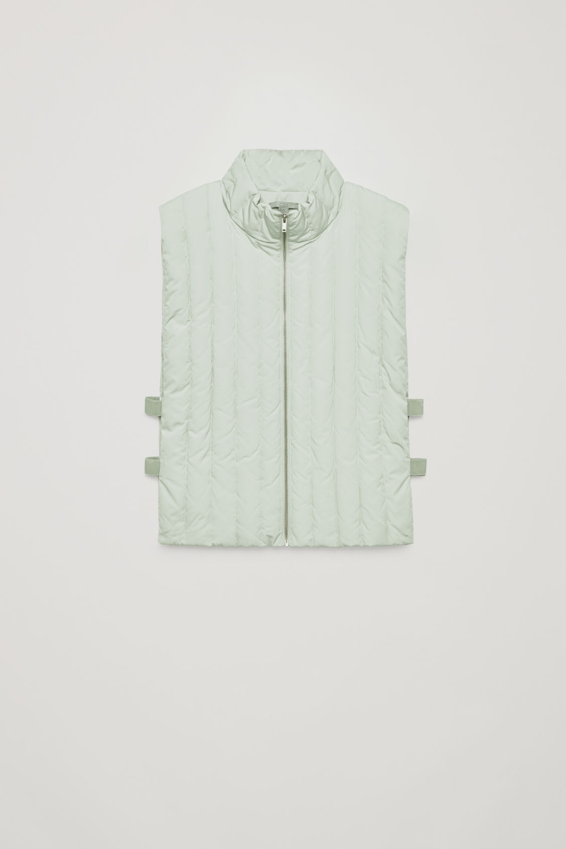 Front image of Cos padded gilet with elastic detail in green