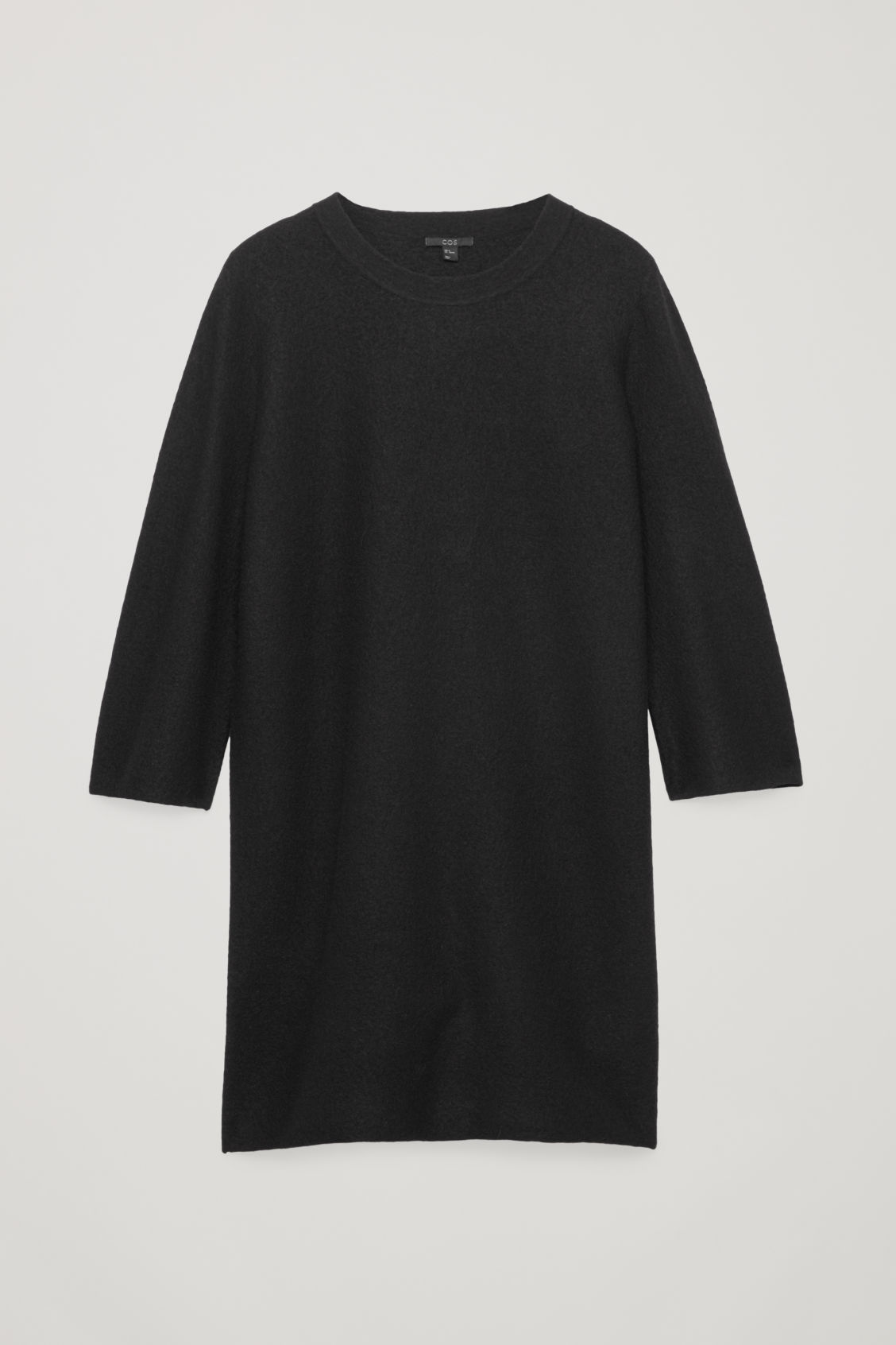 Front image of Cos boiled wool jumper dress in black