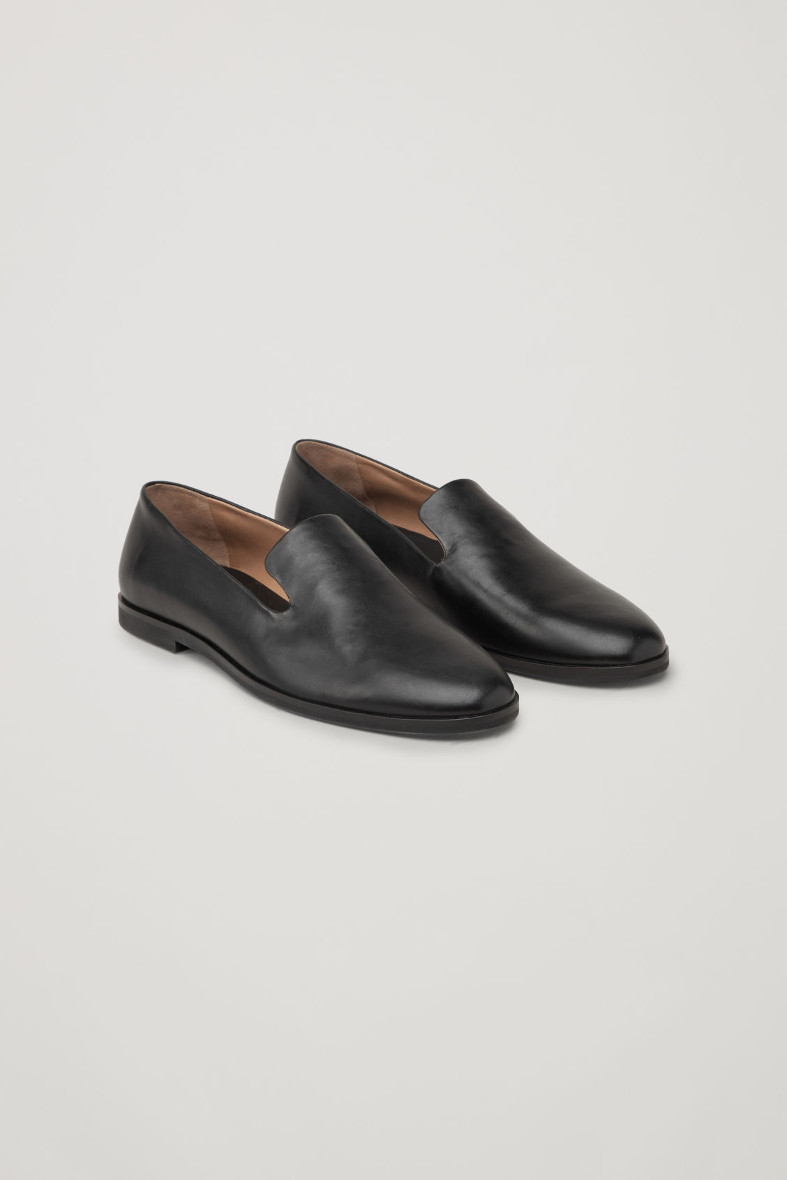 Front image of Cos leather slip-on shoes in black